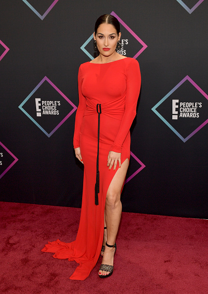 One hit for the Bella sisters! Nikki Bella stunned in this red slit dress on the carpet today. The sleek do, the minimal makeup with the bold lip was a great choice. We could have lived without the black dangling rope though. (Photo by Matt Winkelmeyer/Getty Images)