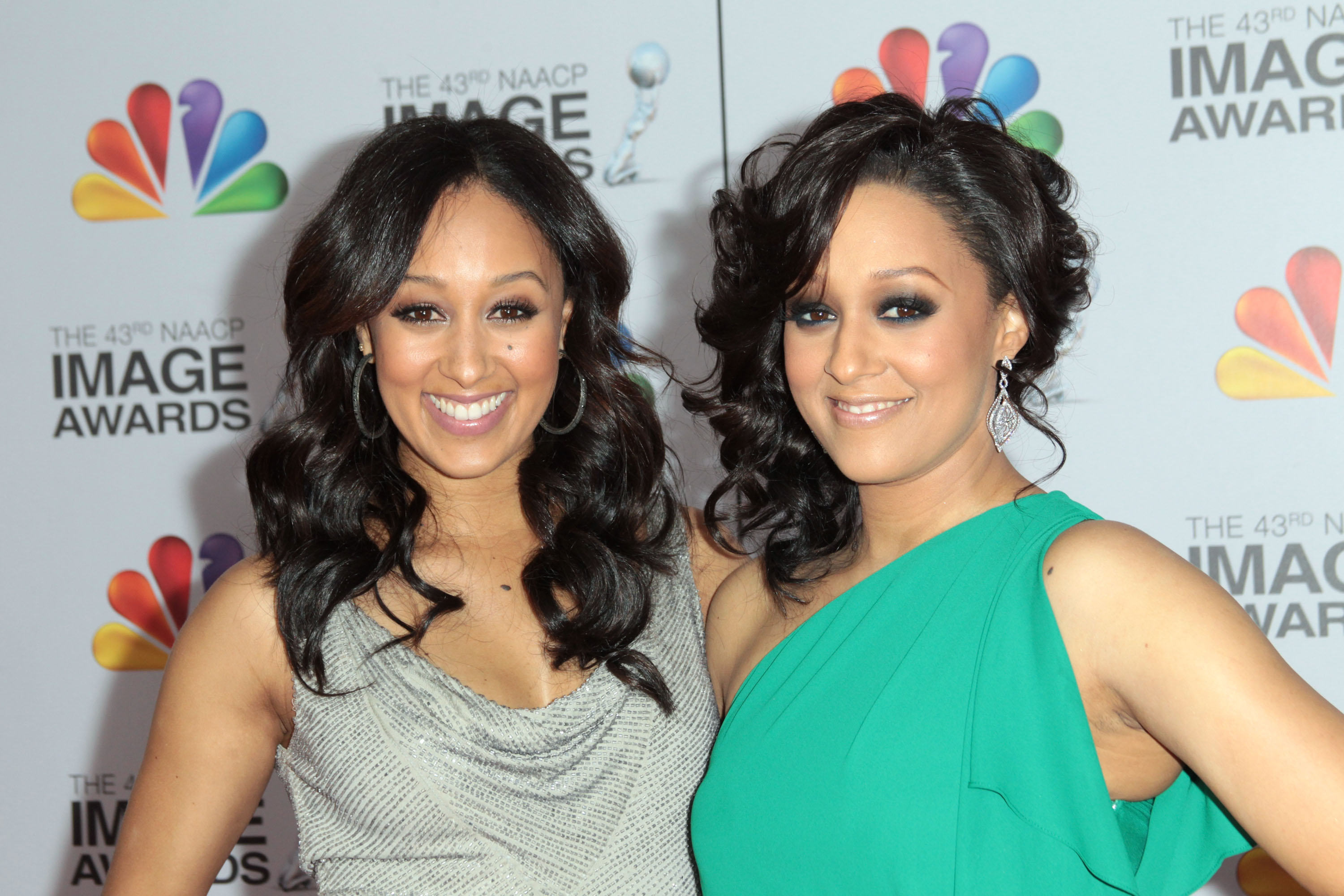 Actresses Tamera Mowry-Housley (L) and Tia Mowry arrive at the 43rd NAACP Image Awards held at The Shrine Auditorium on February 17, 2012 in Los Angeles, California.
