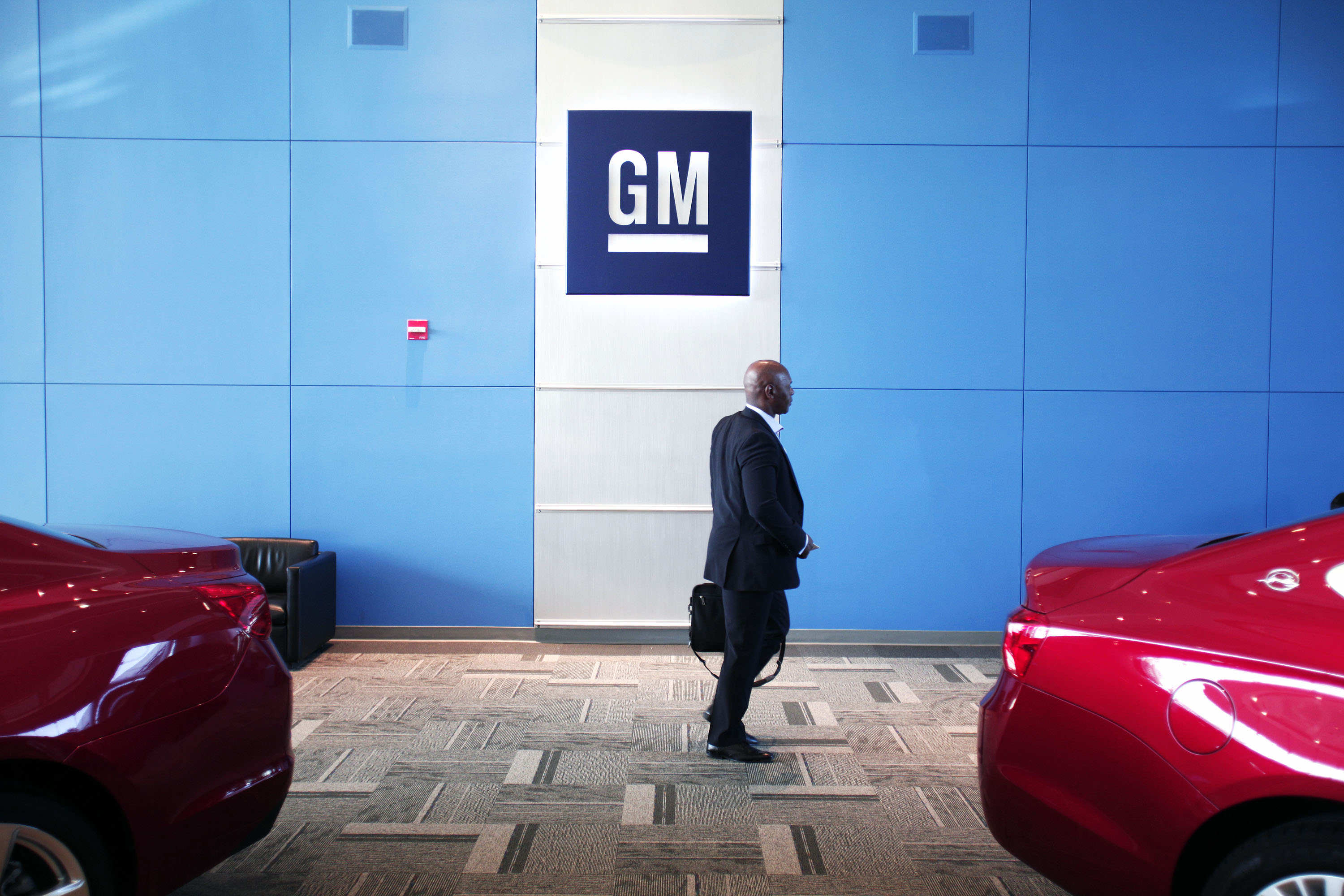 A person walks past the GM logo at the General Motors Technical Center as General Motors Chief Executive Officer Mary Barra holds a press conference on June 5, 2014 in Warren, Michigan.