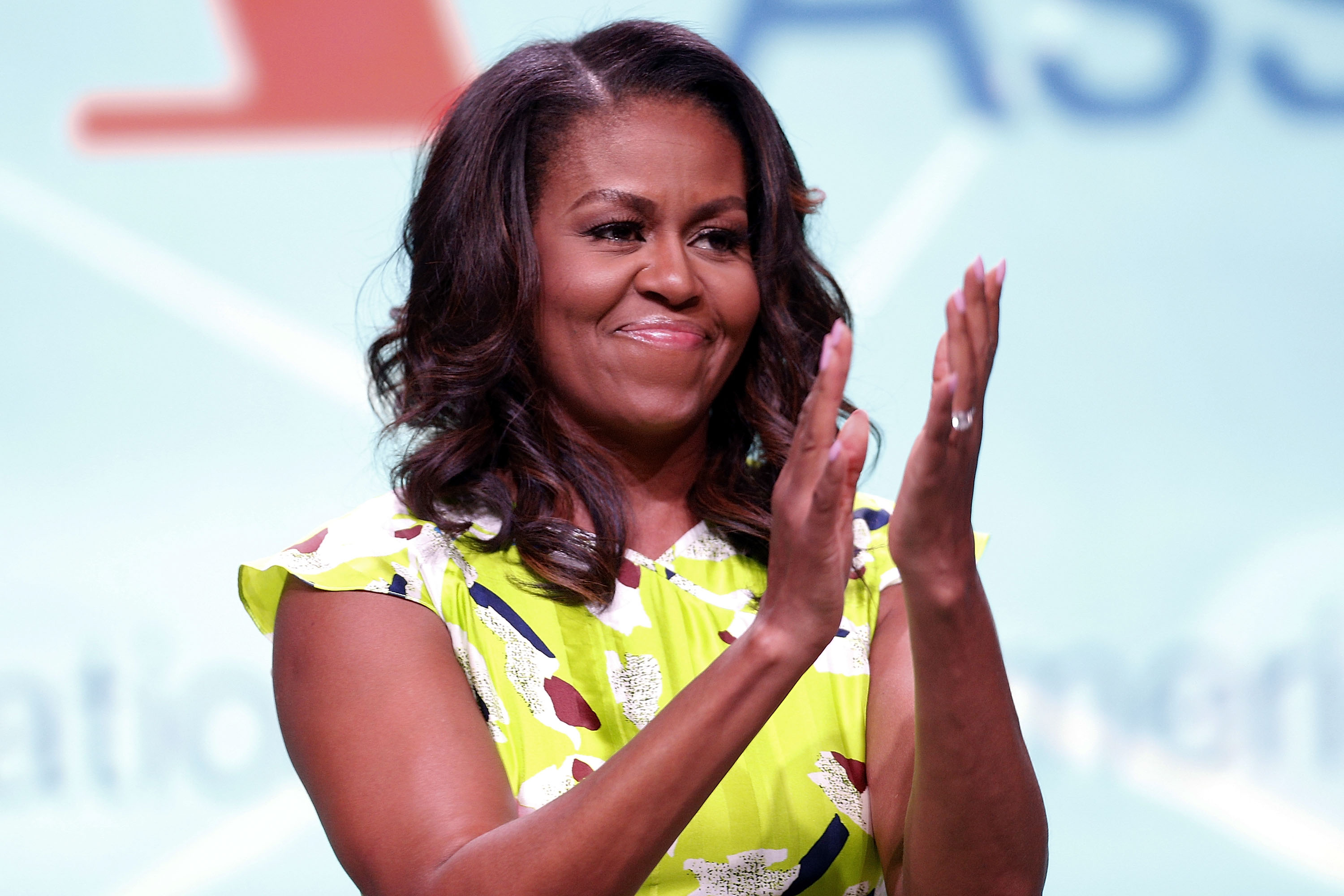 Former U.S. first lady Michelle Obama waves after discussing her forthcoming memoir titled, 'Becoming', during the 2018 American Library Association Annual Conference on June 22, 2018, in New Orleans, Louisiana. (Getty Images)
