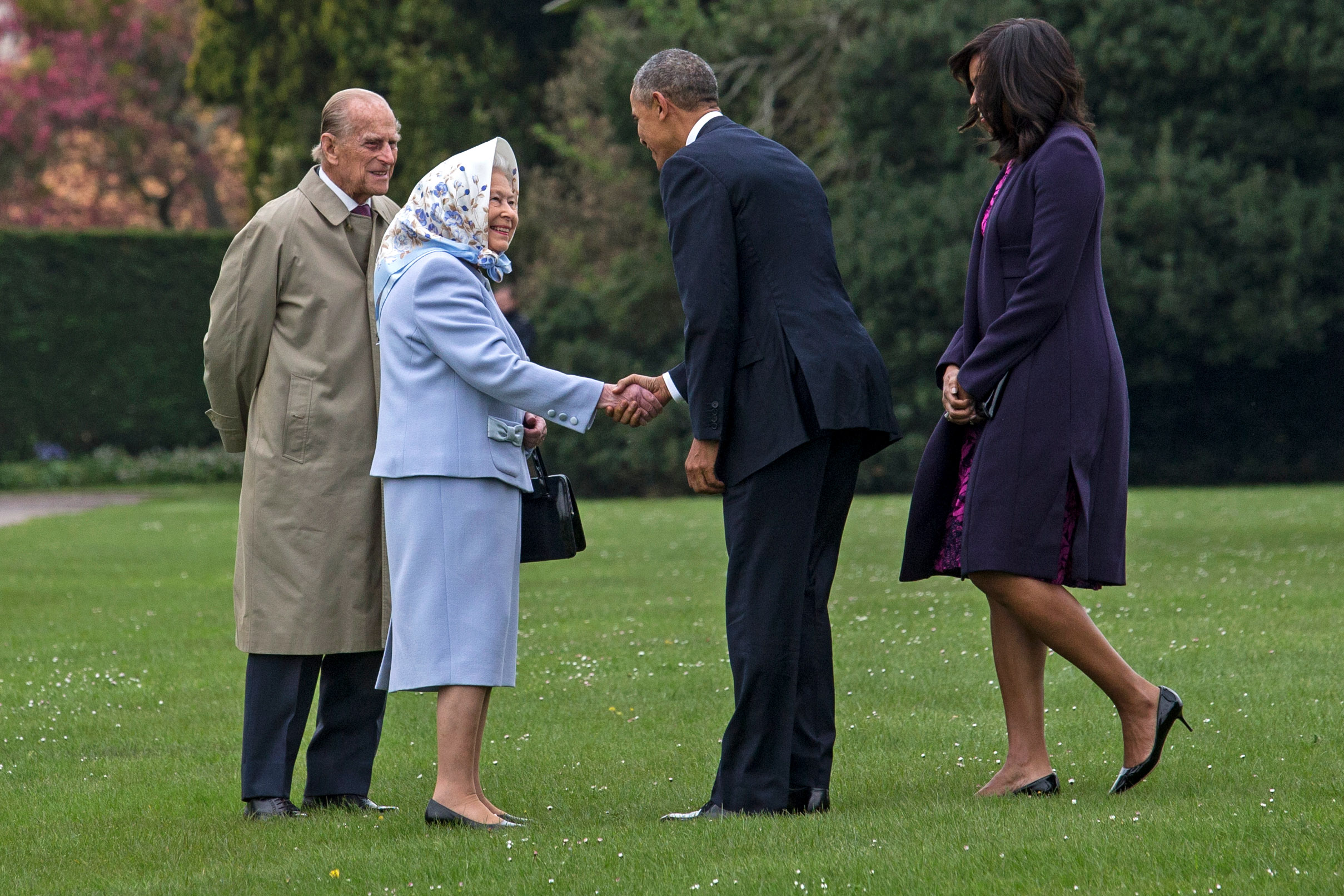 US President Barack Obama and his wife First Lady Michelle Obama are greeted by Queen Elizabeth II and Prince Phillip, Duke of Edinburgh after landing by helicopter at Windsor Castle for a private lunch on April 22, 2016 in Windsor, England. The President and his wife are currently on a brief visit to the UK where they will have lunch with HM Queen Elizabeth II at Windsor Castle and dinner with Prince William and his wife Catherine, Duchess of Cambridge at Kensington Palace. Mr Obama will visit 10 Downing Street on Friday afternoon where he is to hold a joint press conference with British Prime Minister David Cameron and is expected to make his case for the UK to remain inside the European Union.