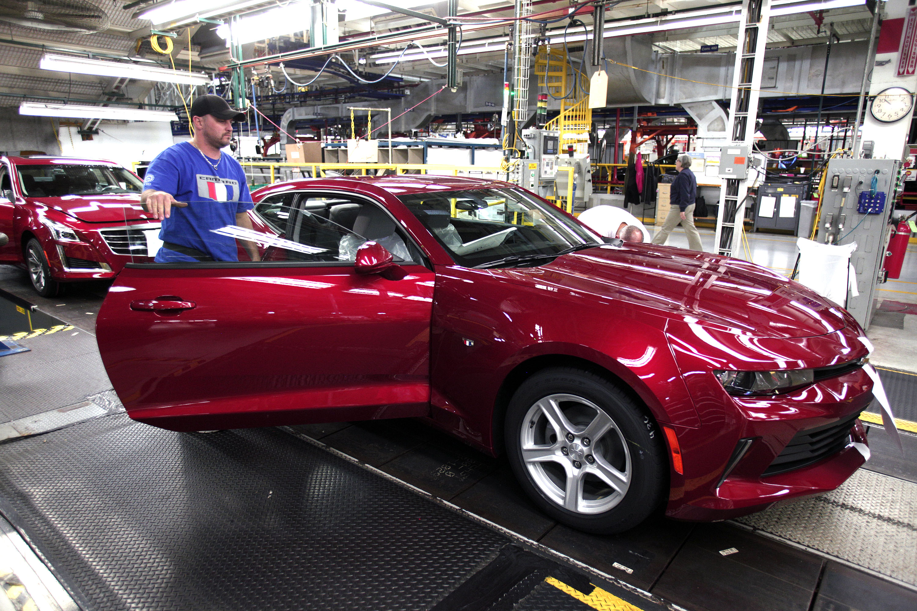 A GM worker puts the finishing touches on a new General Motors 2016 Chevrolet Camaro as it rolls off the production line at GM's Lansing Grand River Assembly Plant October 26, 2015 in Lansing, Michigan.