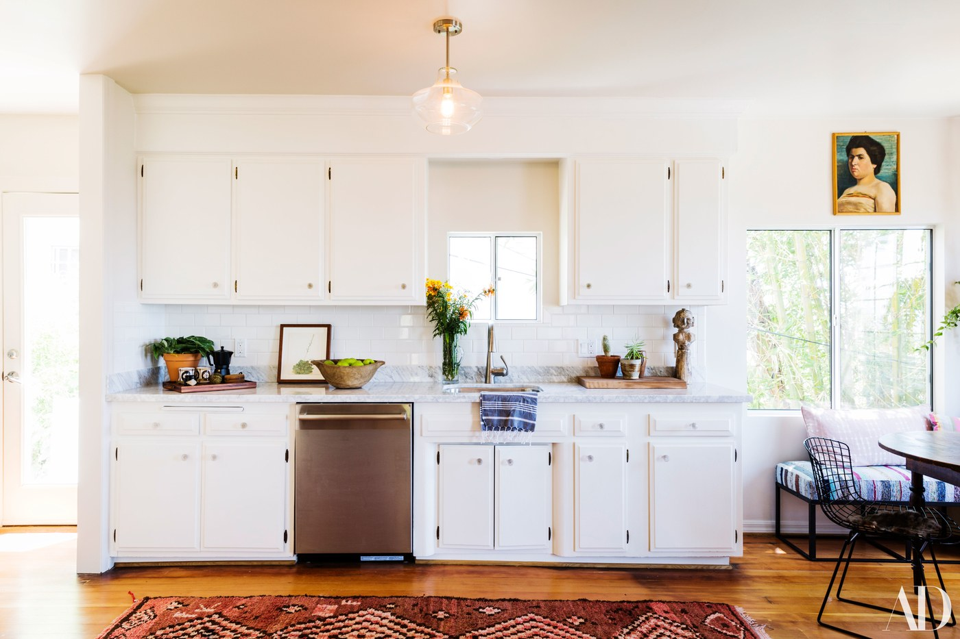 Blazek kept the 90-year-old home light and airy to complement the incredible view, but added pops of color and vintage pieces to embrace List's bohemian style.
