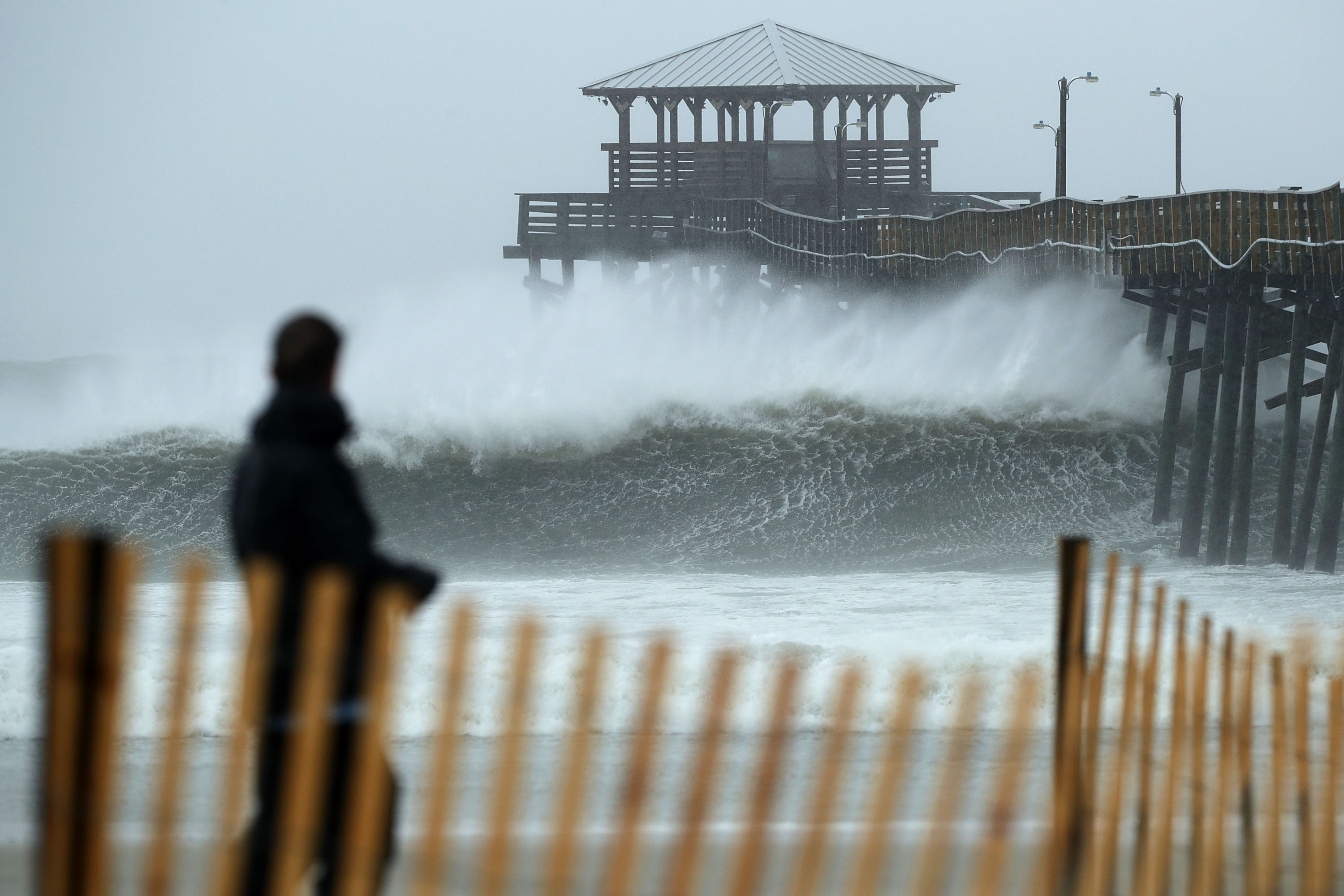Waves crash underneath the Oceanana Pier as the outer bands of Hurricane Florence being to affect the coast September 13, 2018 in Atlantic Beach, United States. Coastal cities in North Carolina, South Carolina and Virginia are under evacuation orders as the Category 2 hurricane approaches the United States.