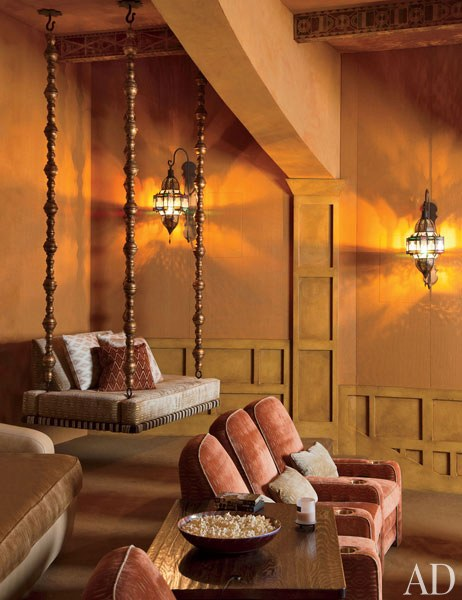 Screening Room: The family's screening room includes luxuriously upholstered club chairs, a cushioned daybed suspended from the ceiling, classically styled millwork, and Moroccan lanterns. Roger Davies 2011