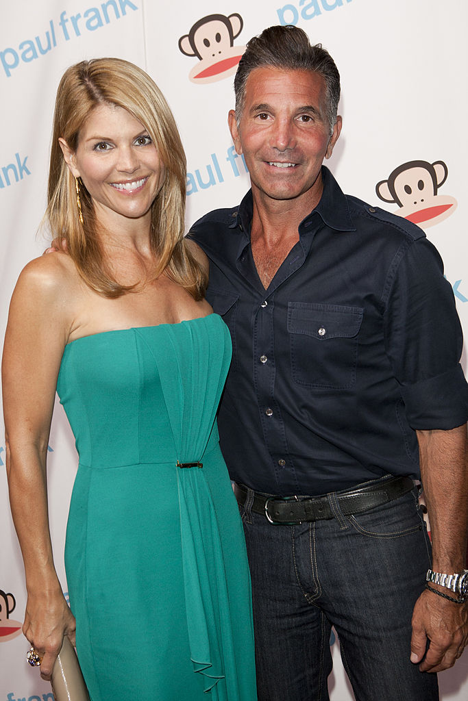 Lori Loughlin and husband Mossimo Giannulli attend Paul Frank's celebration of Fashion's Night Out at ADBD Gallery on September 8, 2011, in Los Angeles, California. (Source: Michael Bezjian/Getty Images)