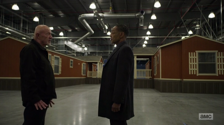 Mike and Gus scope out a warehouse for living accommodations (Source: AMC)