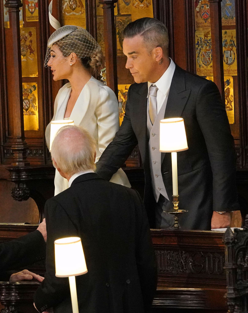 Robbie Williams and Ayda Field take their seats ahead of the wedding of Princess Eugenie of York to Jack Brooksbank at Windsor Castle on October 12, 2018, in Windsor, England. (Getty Images)