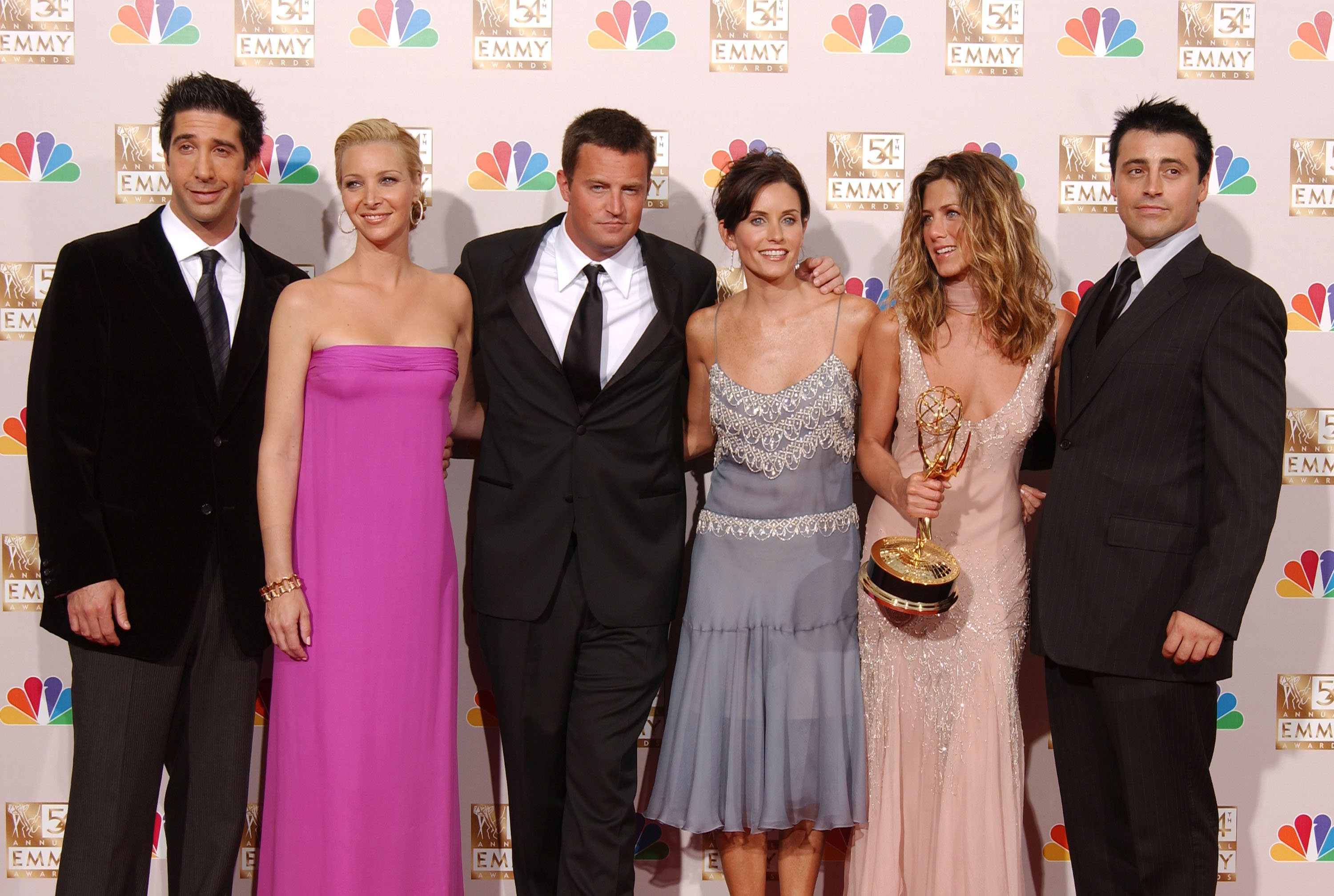 (L to R) Actors David Schwimmer, Lisa Kudrow, Matthew Perry, Courteney Cox Arquette, Jennifer Aniston and Matt LeBlanc pose backstage during the 54th Annual Primetime Emmy Awards at the Shrine Auditorium on September 22, 2002 in Los Angeles, California. Aniston won Outstanding Lead Actress in a Comedy Series for 'Friends.'