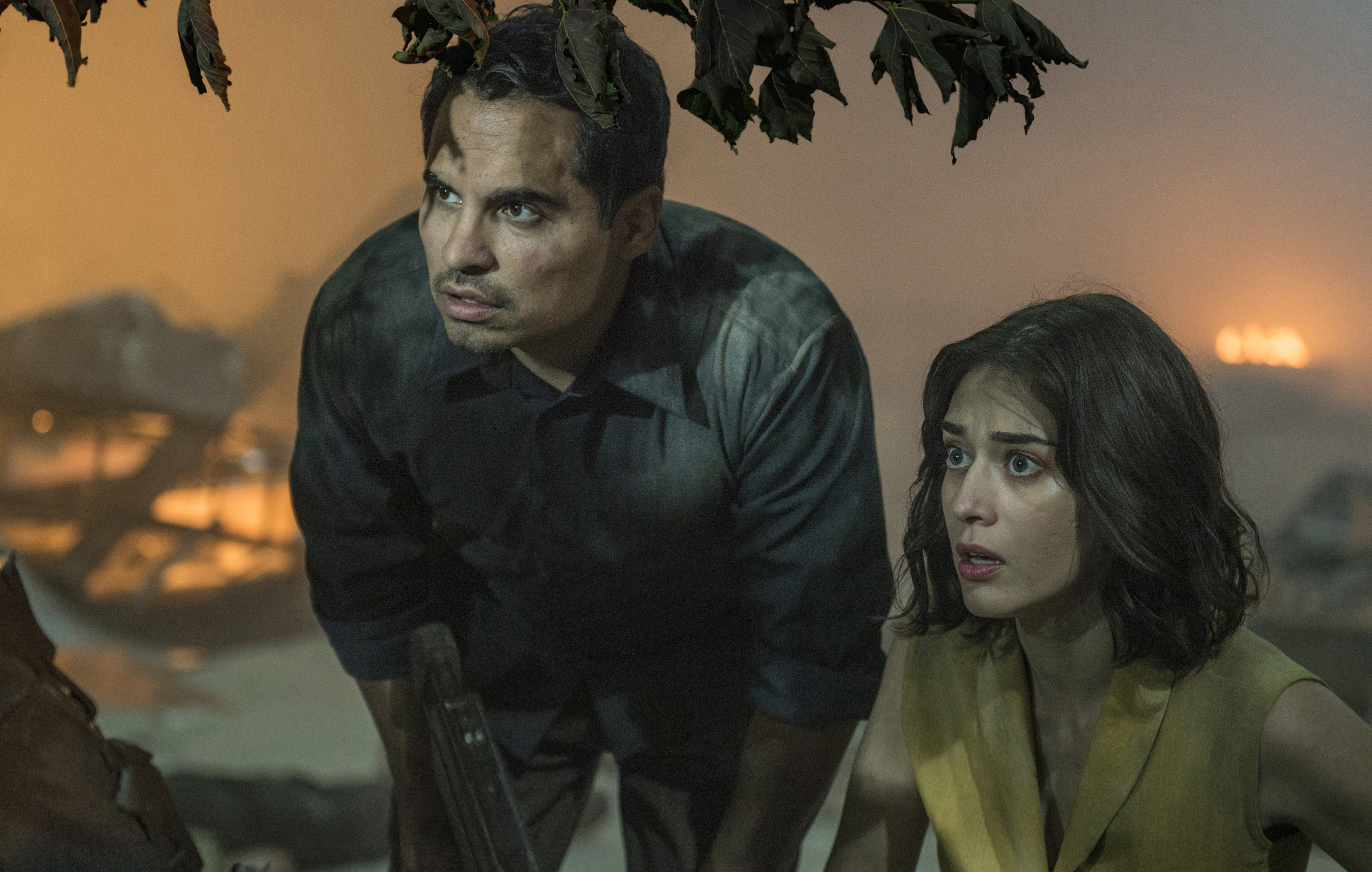 Michael Pena and Lizzy Caplan star in 'Extinction', due for global release on July 27 via Netflix.