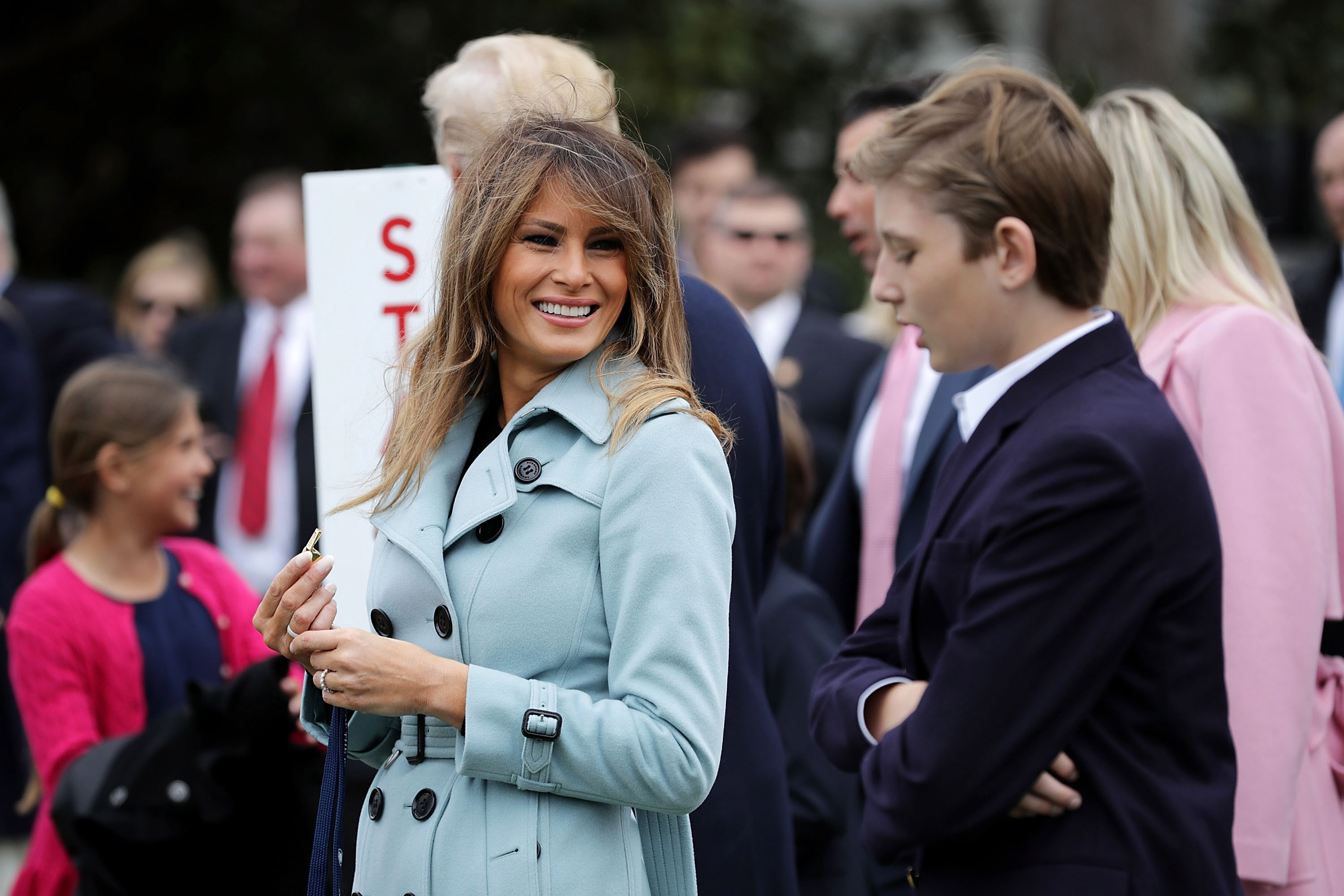 US. first lady Melania Trump (C) and her son Barron Trump attend the 140th annual Easter Egg Roll on the South Lawn of the White House April 2, 2018 in Washington, DC. The White House said they are expecting 30,000 children and adults to participate in the annual tradition of rolling colored eggs down the White House lawn that was started by President Rutherford B. Hayes in 1878.
