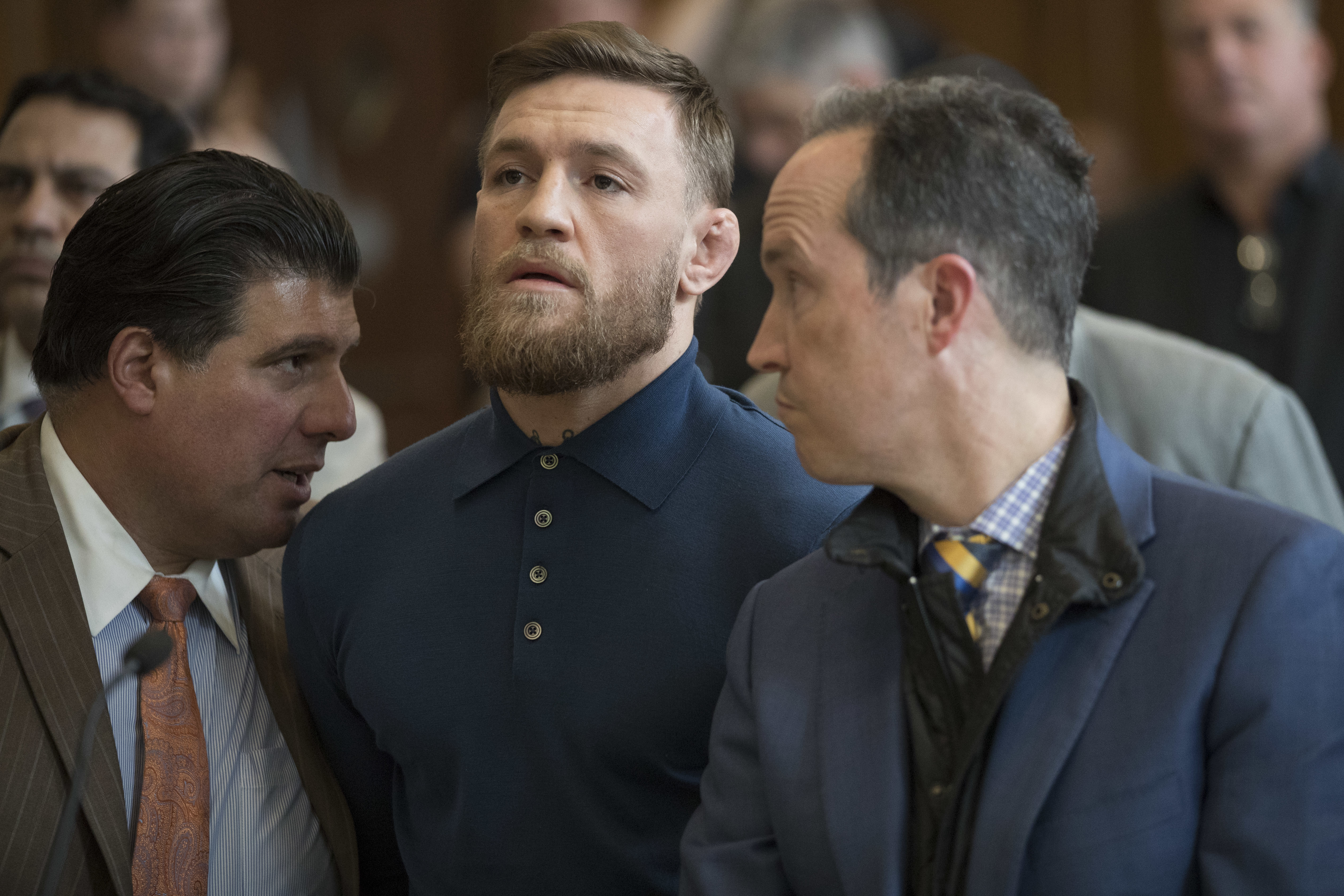 Ultimate fighting star Conor McGregor stands with his lawyer Jim Walden during an arraignment in Brooklyn Criminal court on April 6, 2018 in New York City. McGregor is facing criminal charges in the wake of a backstage melee he allegedly instigated that has forced the removal of three fighters from UFC's biggest card of the year. Video footage appears to show the promotion's most bankable star throwing a hand truck at a bus full of fighters after a Thursday news conference for UFC 223 at Brooklyn's Barclays Center.