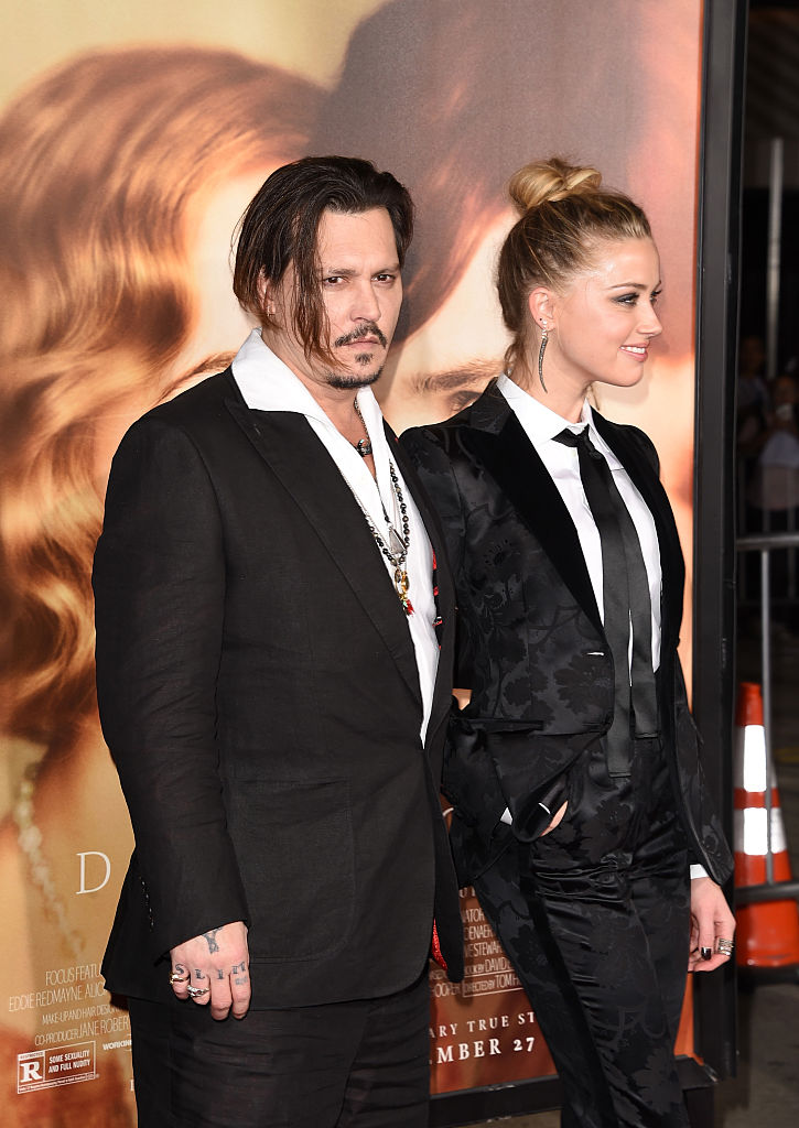 Johnny Depp and Amber Heard attend the premiere of Focus Features' 'The Danish Girl' at Westwood Village Theatre on November 21, 2015 in Westwood, California. (Photo by Jason Merritt/Getty Images)