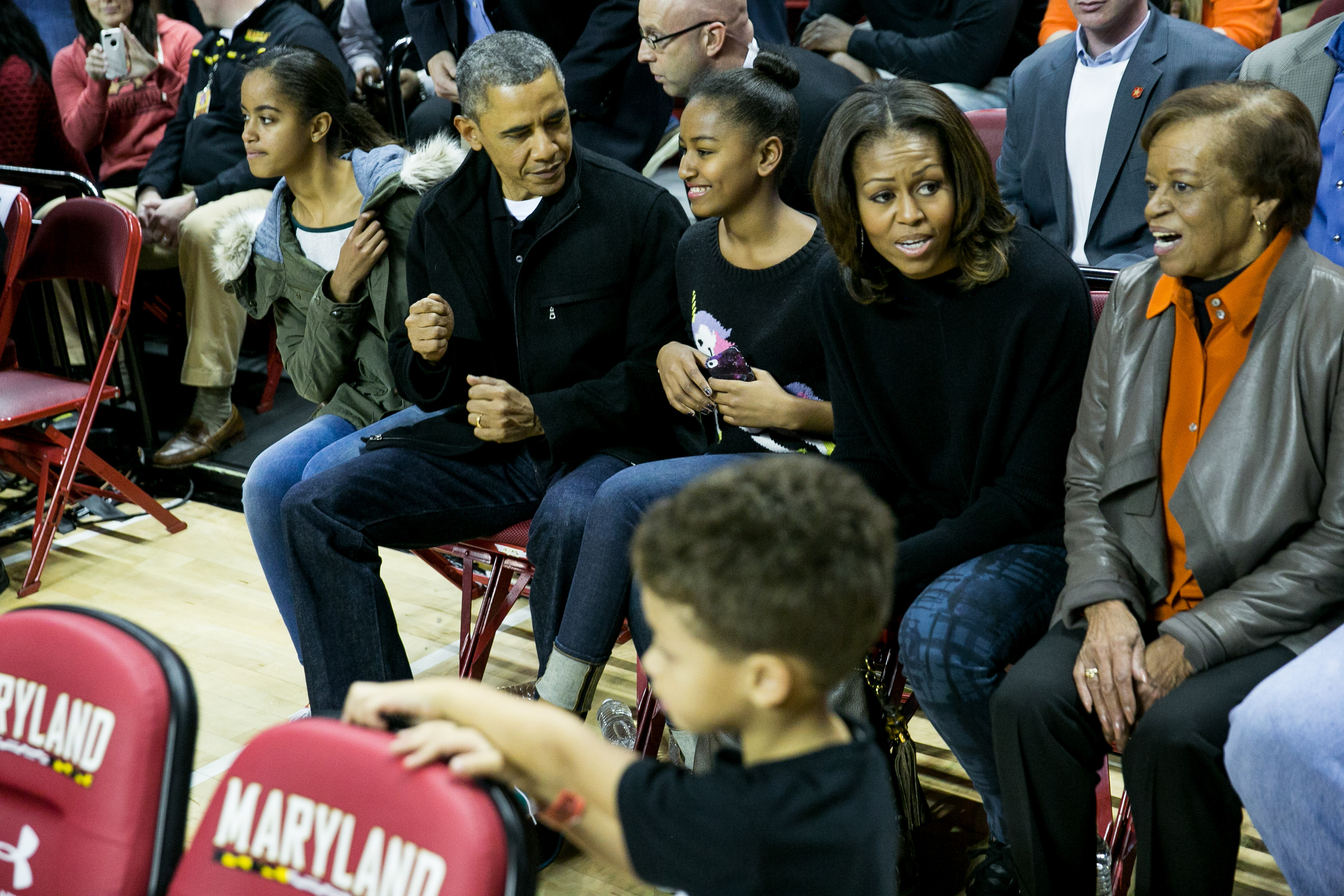 U.S. President Barack Obama, daughters Malia Obama and Sasha Obama, First Lady Michelle Obama and Marian Robinson (R) attend a men's NCCA basketball game between the University of Maryland and Oregon State University, November 17, 2013, at Comcast Center in College Park, Maryland. (Photo by Drew Angerer/Getty Images)