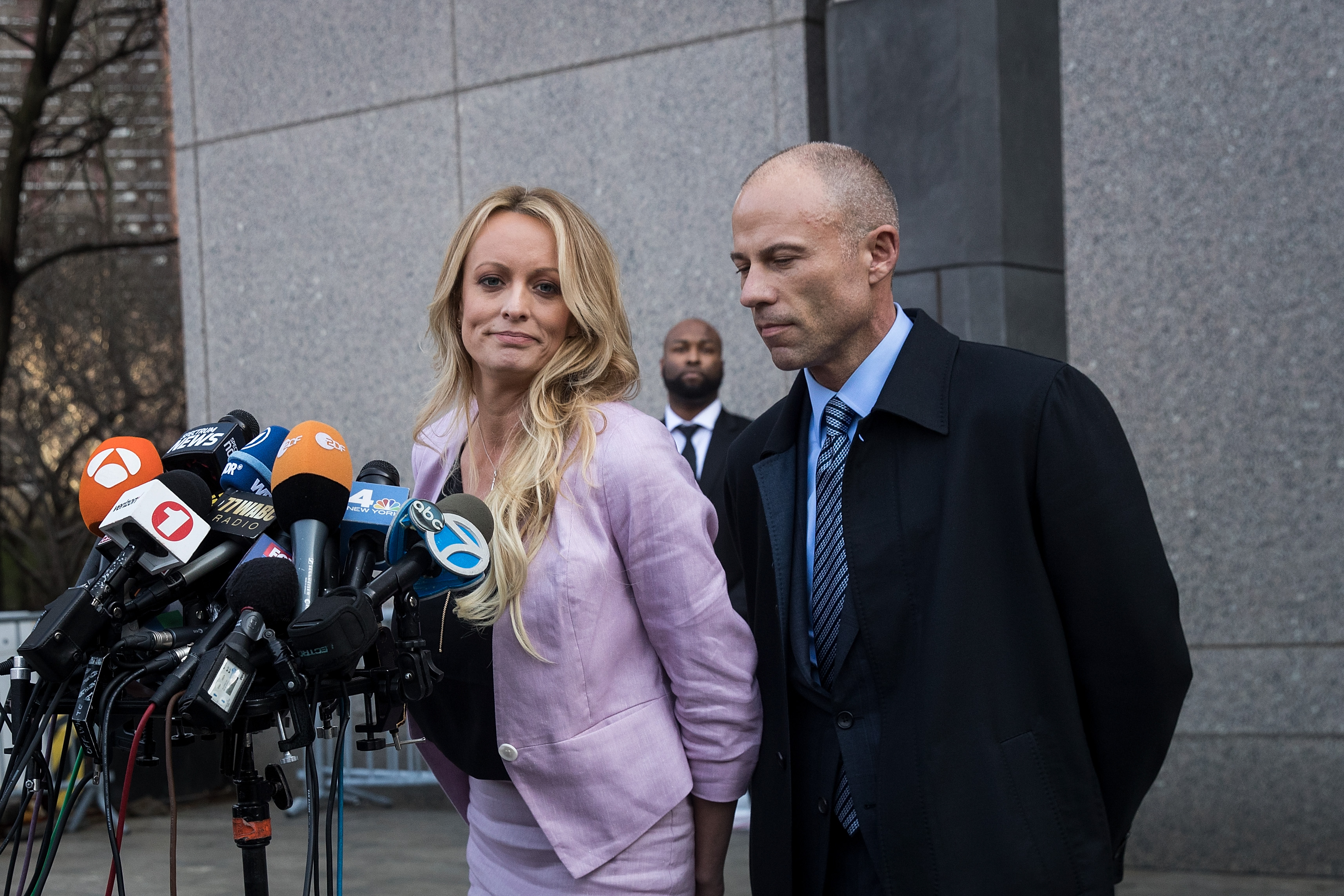 (L to R) Adult film actress Stormy Daniels (Stephanie Clifford) and Michael Avenatti, attorney for Stormy Daniels, speak to the media as they exit the United States District Court Southern District of New York.