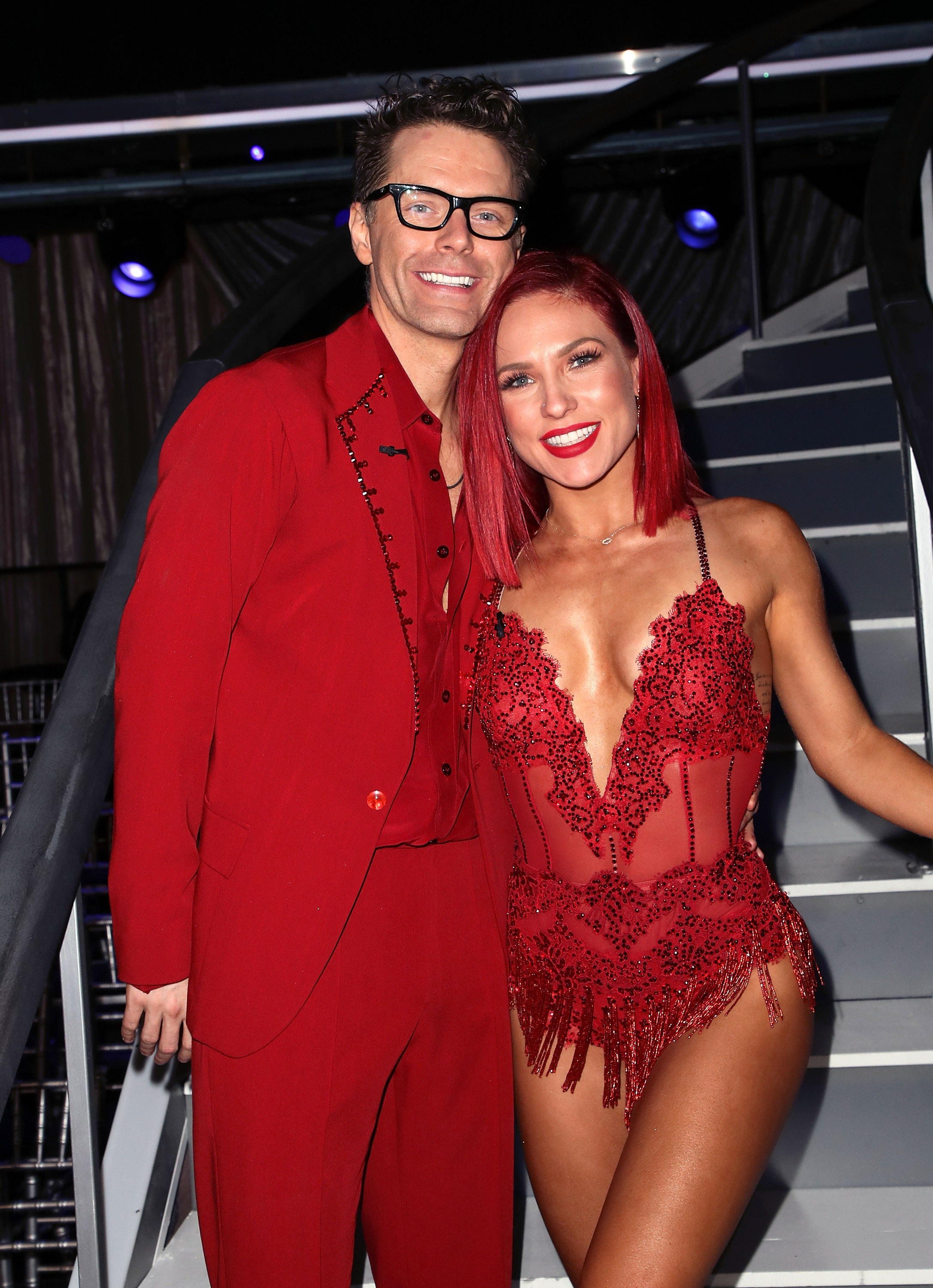 Bobby Bones (L) and Sharna Burgess pose at 'Dancing with the Stars' Season 27 at CBS Television City on September 24, 2018 in Los Angeles, California.