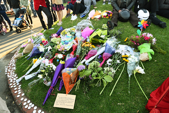 Flowers and condolences laid by locals at the Wellington Vigil held at the Basin Reserve on March 17, 2019, Wellington, New Zealand. 50 people are confirmed dead, with 36 injured still in hospital following shooting attacks on two mosques in Christchurch on Friday, 15th March (Source: Getty Images)