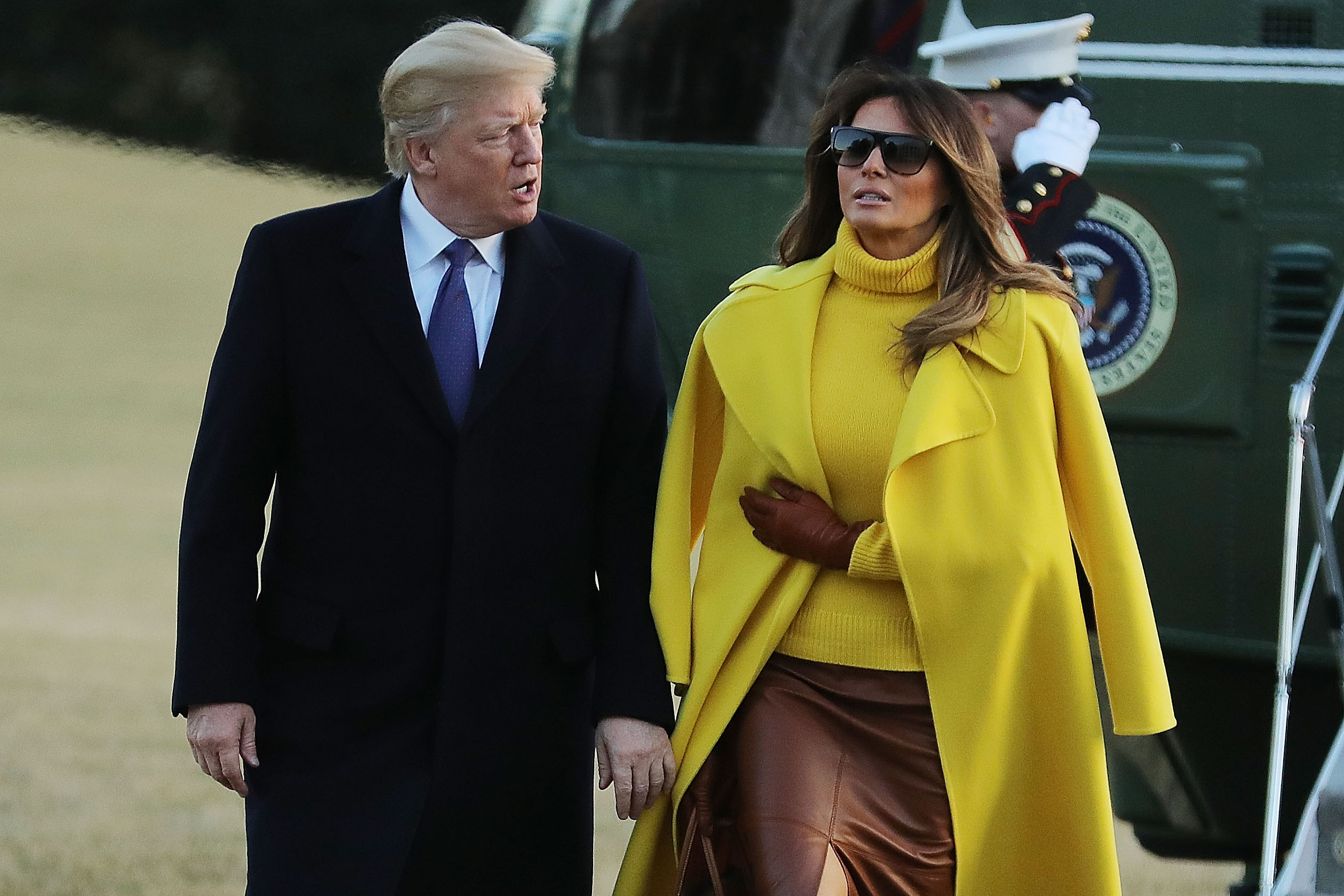 U.S. President Donald Trump (L) and first lady Melania Trump return to the White House after a day trip to Cincinnati, Ohio, February 5, 2018 in Washington, DC. While in Ohio President Trump delivered remarks after touring cylinder manufacturer Sheffer Corporation while the first lady visited patients and their families at Cincinnati Children's Hospital Medical Center.