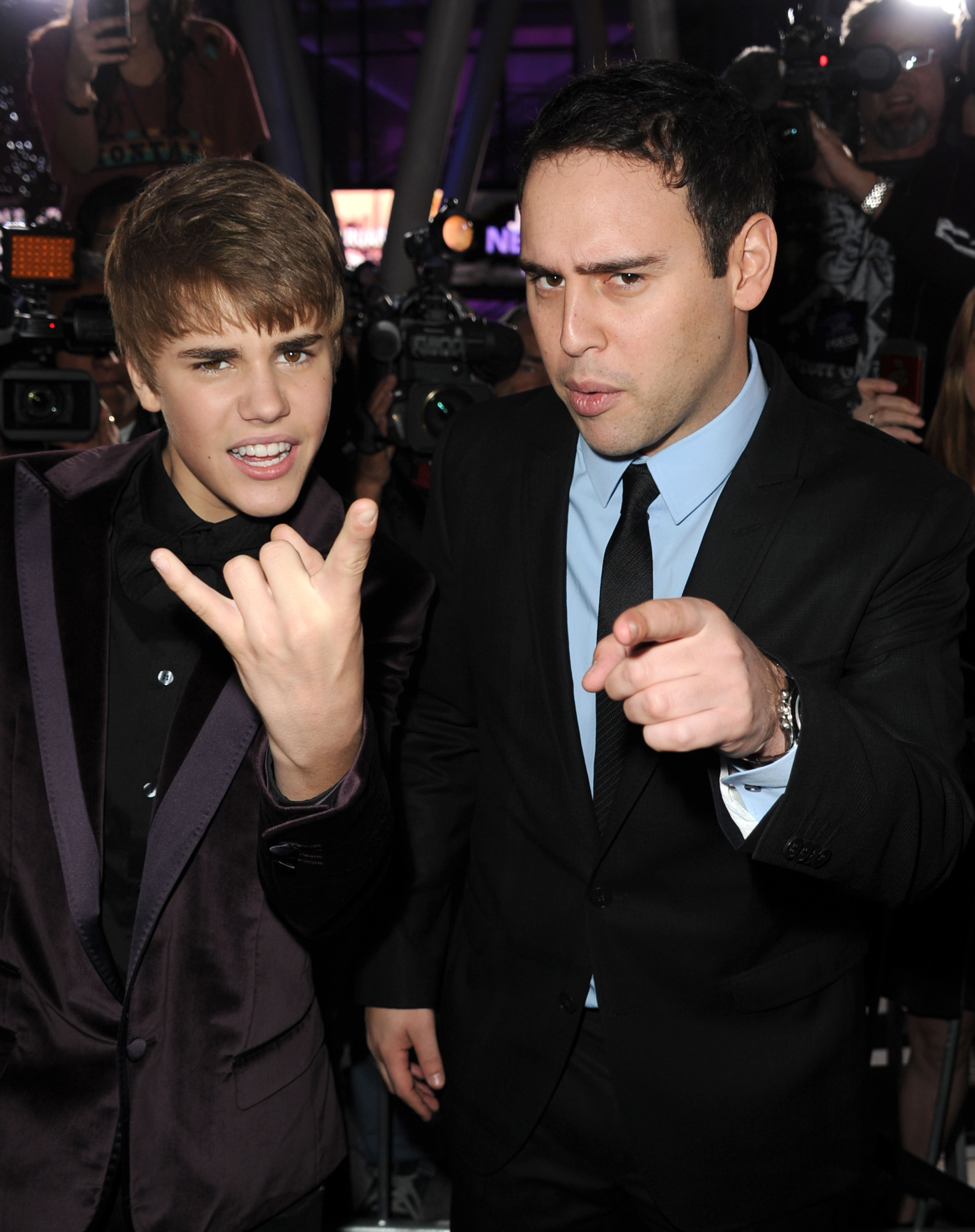Singer Justin Bieber (L) and manager Scooter Braun arrive at the premiere of Paramount Pictures' 'Justin Bieber: Never Say Never' held at Nokia Theater L.A. Live on February 8, 2011 in Los Angeles, California.