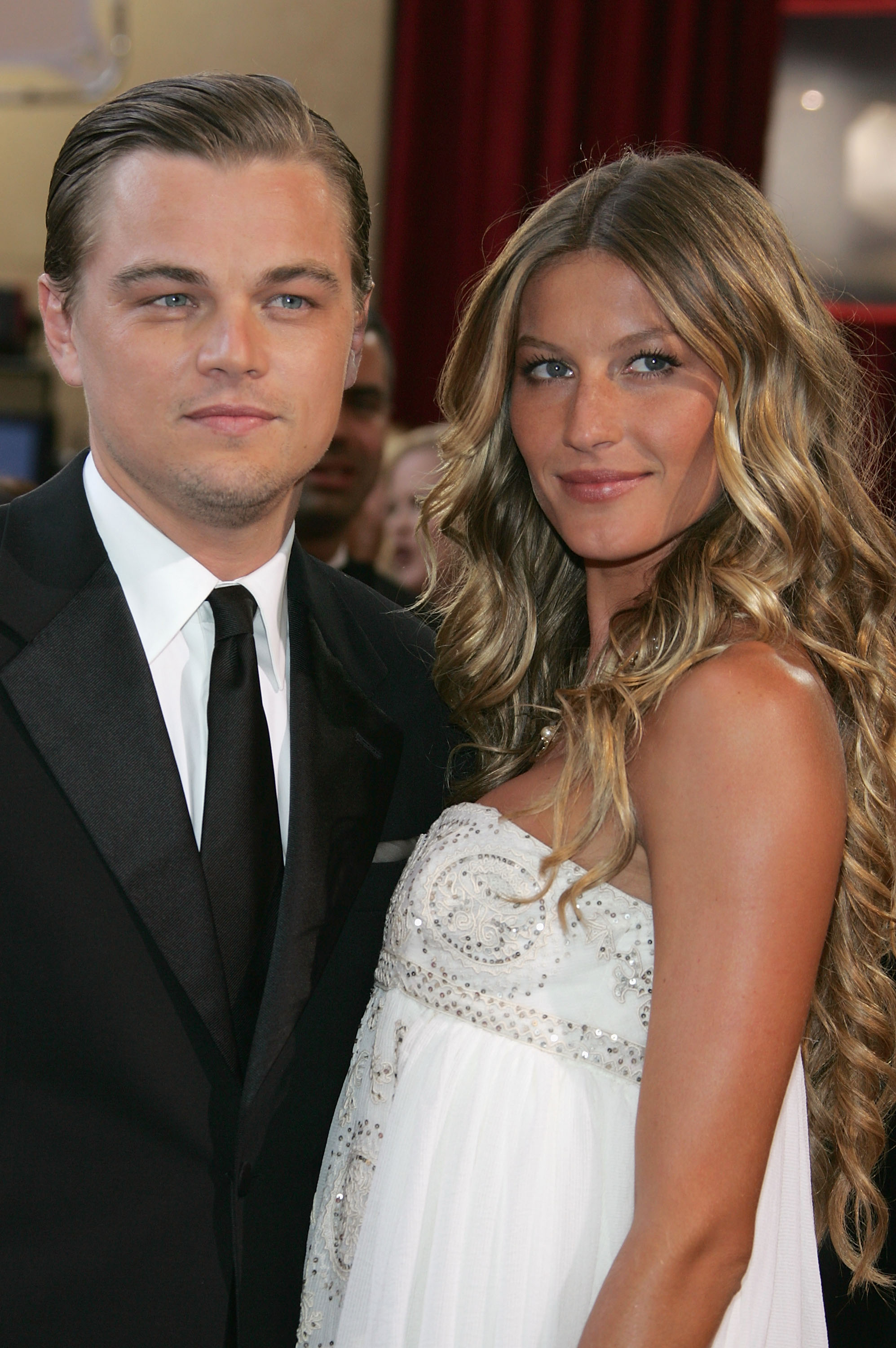 Actor Leonardo DiCaprio, nominated for Best Actor for his role in 'The Aviator,' arrives with girlfriend Brazilian model Gisele Bundchen at the 77th Annual Academy Awards at the Kodak Theater on February 27, 2005 in Hollywood, California.