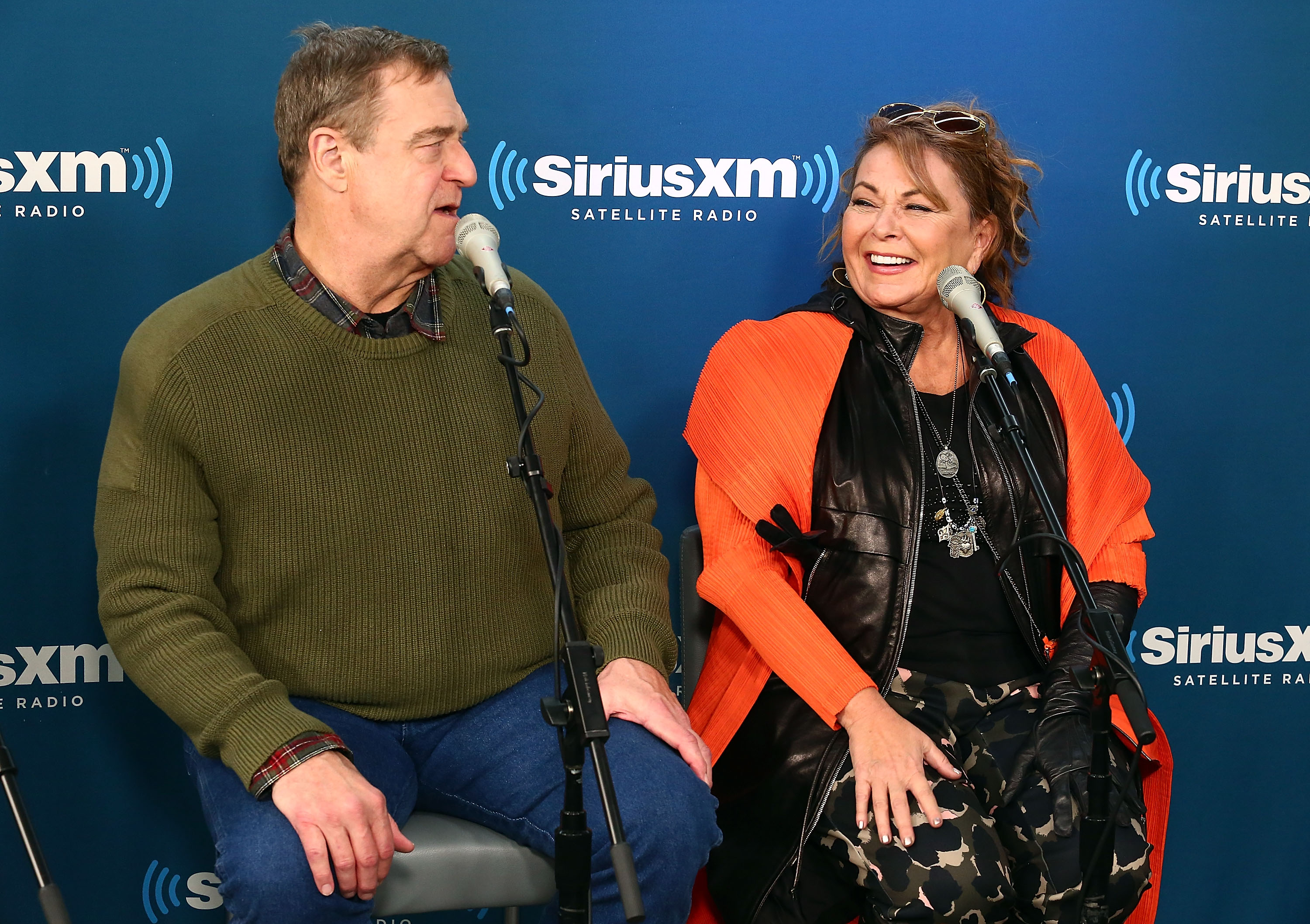 (L-R) Actors John Goodman and Roseanne Barr speak during SiriusXM's Town Hall with the cast of Roseanne on March 27, 2018 in New York City.