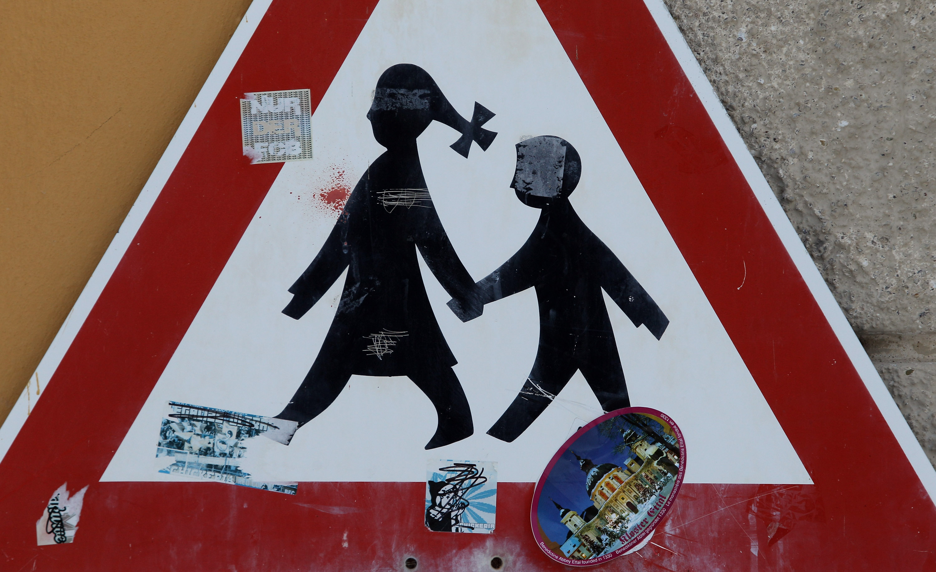 A traffic sign depicting children is pictured at the Benedictine-run Ettal Monastery is pictured on March 12, 2010 in Ettal, Germany. (Getty Images)