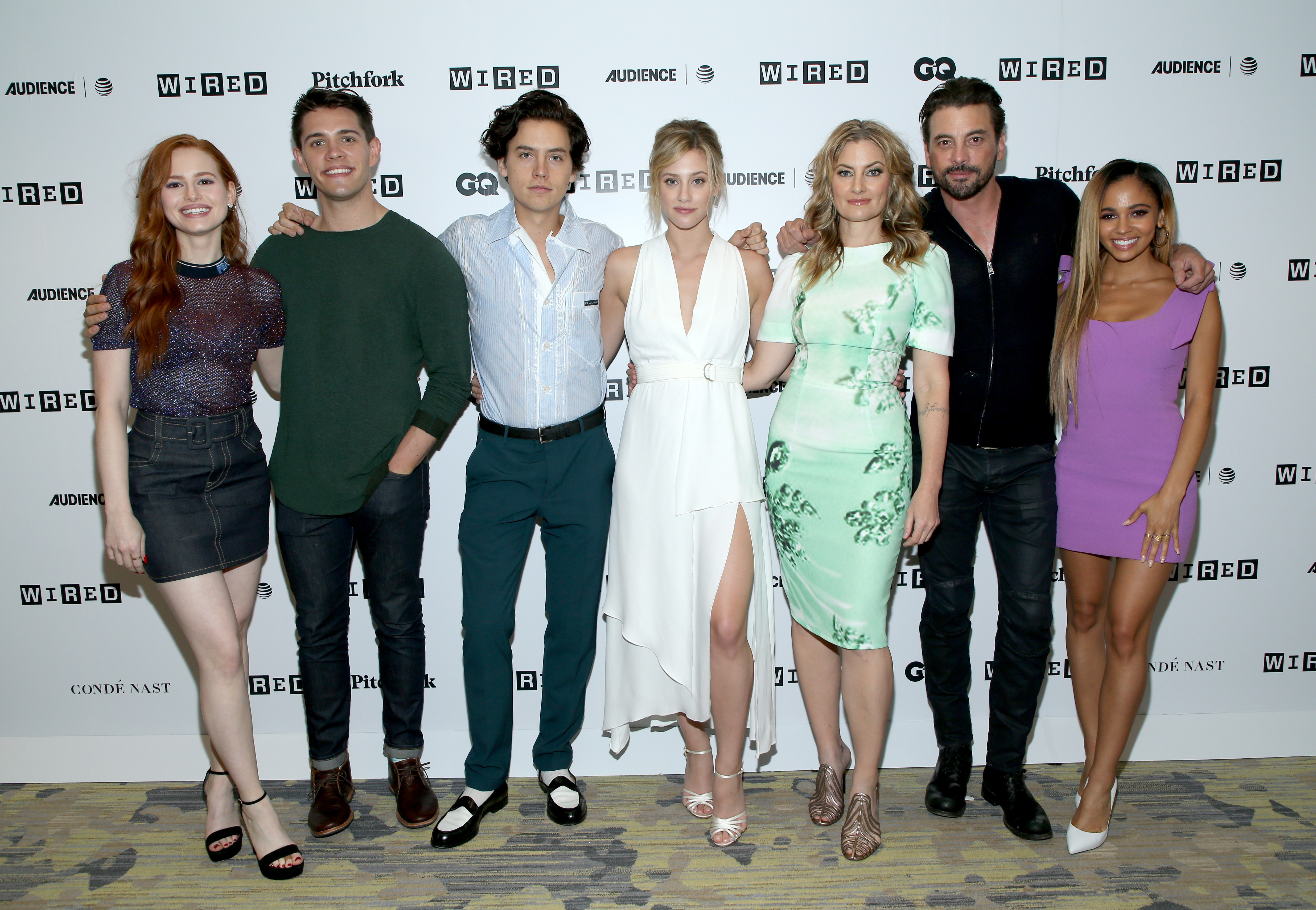(L-R) Madelaine Petsch, Casey Cott, Cole Sprouse, Lili Reinhart, Madchen Amick, Skeet Ulrich, and Vanessa Morgan of 'Riverdale' attends the 2018 WIRED Cafe at Comic Con presented by AT&T Audience Network at Omni Hotel on July 21, 2018 in San Diego, California.
