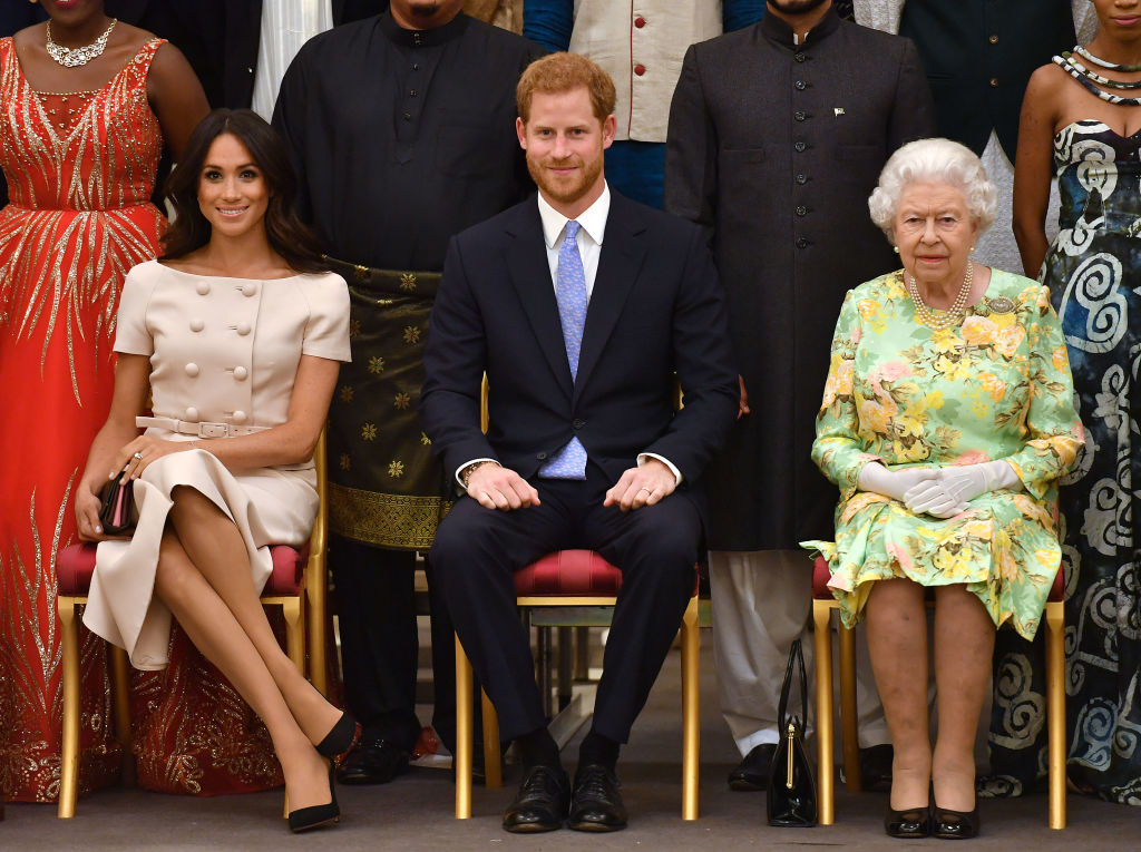 Meghan, Duchess of Sussex, Prince Harry, Duke of Sussex and Queen Elizabeth II at the Queen's Young Leaders Awards Ceremony at Buckingham Palace on June 26, 2018 in London, England. (Photo by John Stillwell - WPA Pool/Getty Images)