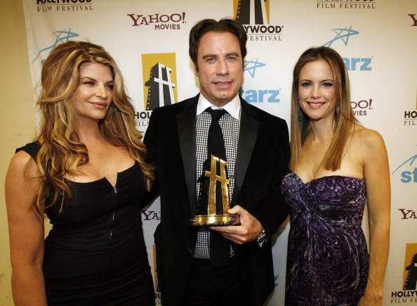 Kirstie Alley, actor John Travolta, and his wife actress Kelly Preston (Photo by Charley Gallay/Getty Images)