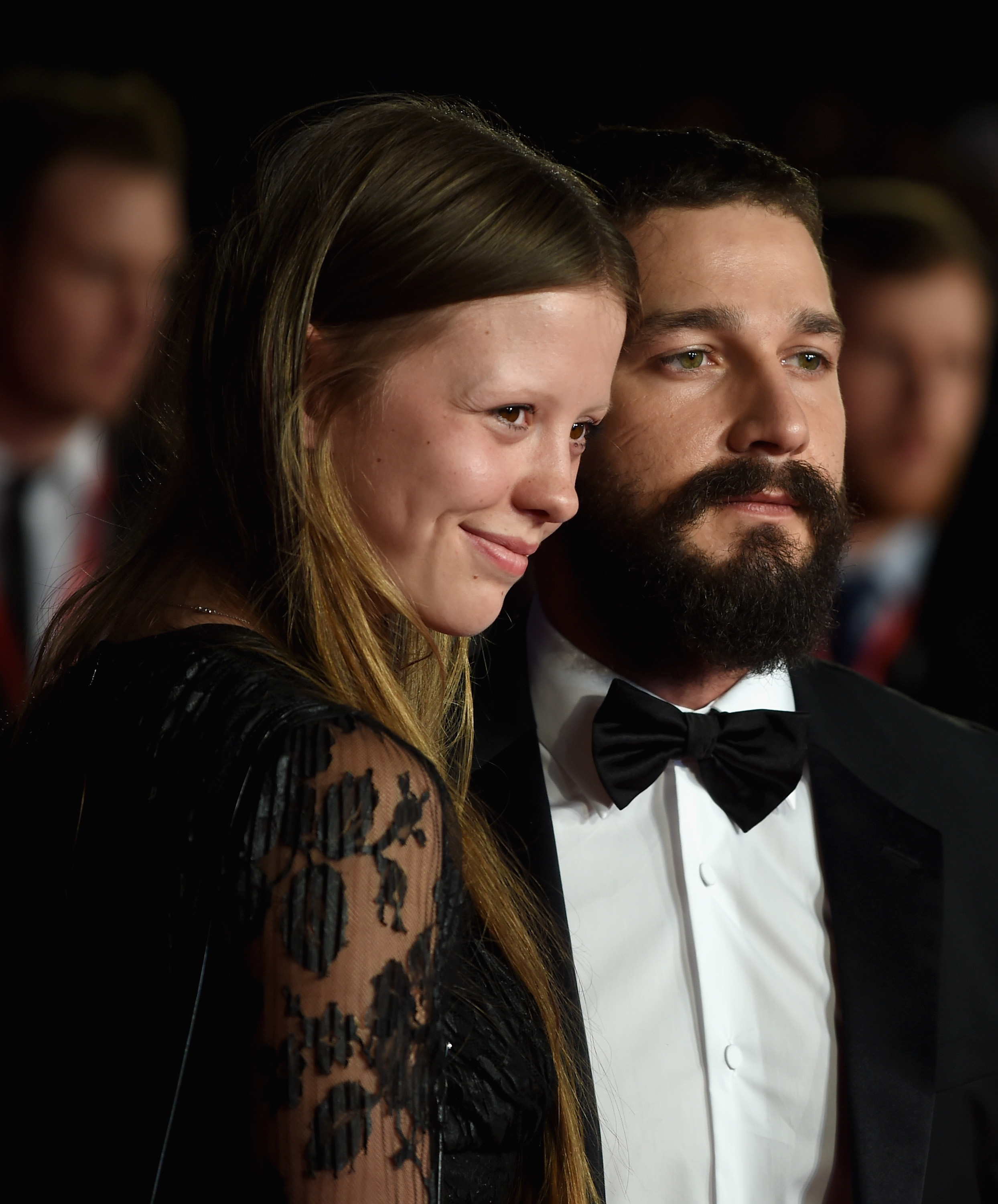 Mia Goth and actor Shia LeBeouf attend the closing night European Premiere gala red carpet arrivals for 'Fury' during the 58th BFI London Film Festival at Odeon Leicester Square on October 19, 2014 in London, England.