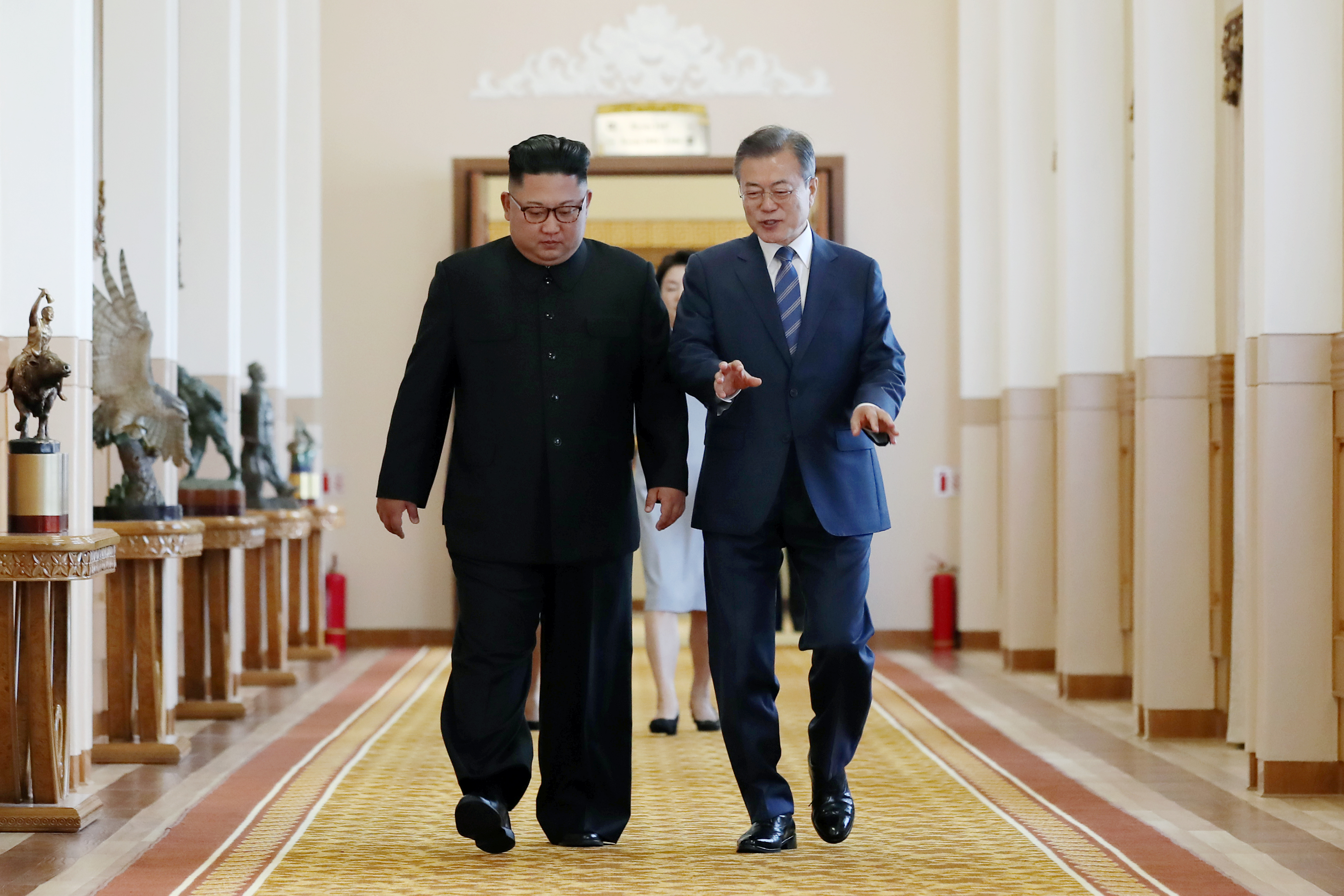 South Korean President Moon Jae-in (R) walks with North Korean leader Kim Jong Un (L) before their meeting at Paekhwawon State Guesthouse on September 19, 2018 in Pyongyang, North Korea. Kim and Moon meet for the Inter-Korean summit talks after the 1945 division of the peninsula, and will discuss ways to denuclearize the Korean Peninsula. (Getty Images)