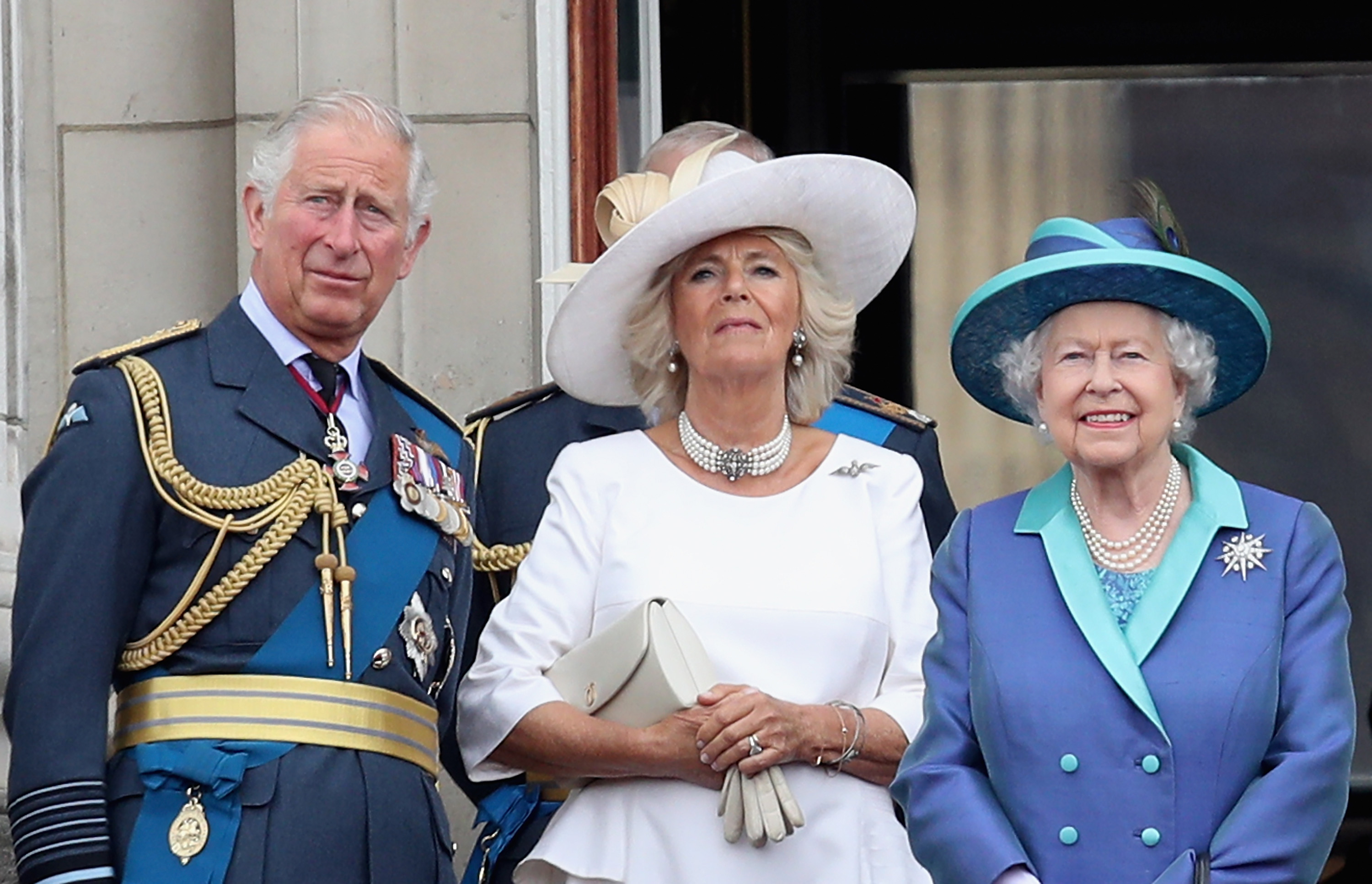 (L-R) Prince Charles, Prince of Wales, Camilla, Duchess of Cornwall, Queen Elizabeth II watch the RAF flypast on the balcony of Buckingham Palace, as members of the Royal Family attend events to mark the centenary of the RAF on July 10, 2018, in London, England. (Getty Images)