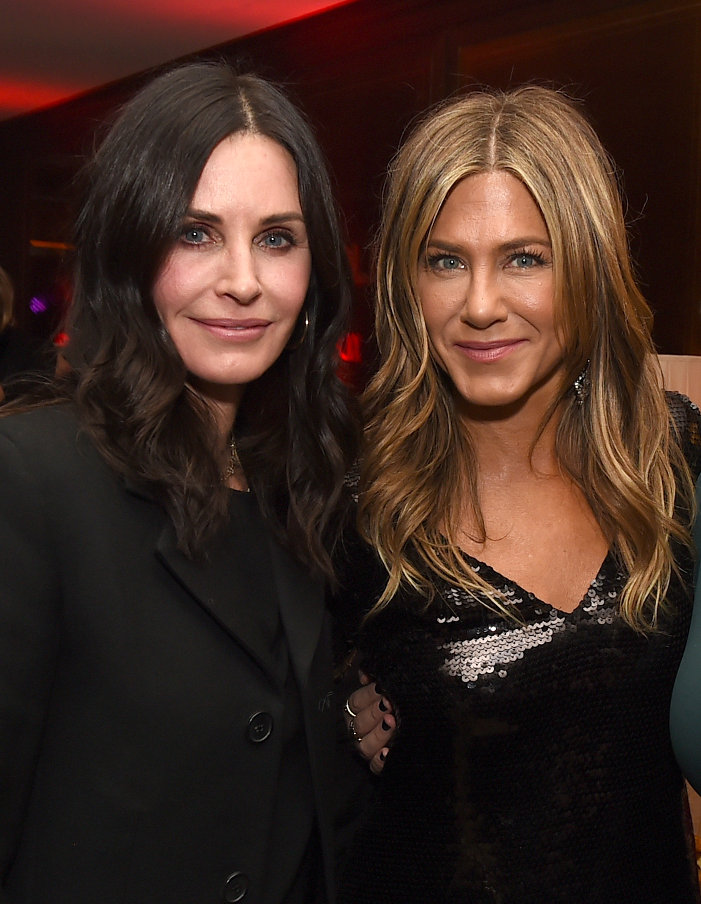 Courteney Cox (L) and Jennifer Aniston pose at the after party for the premiere of Netflix's 'Dumplin'' at Sunset Tower on December 6, 2018 in Los Angeles, California. (Photo by Kevin Winter/Getty Images)