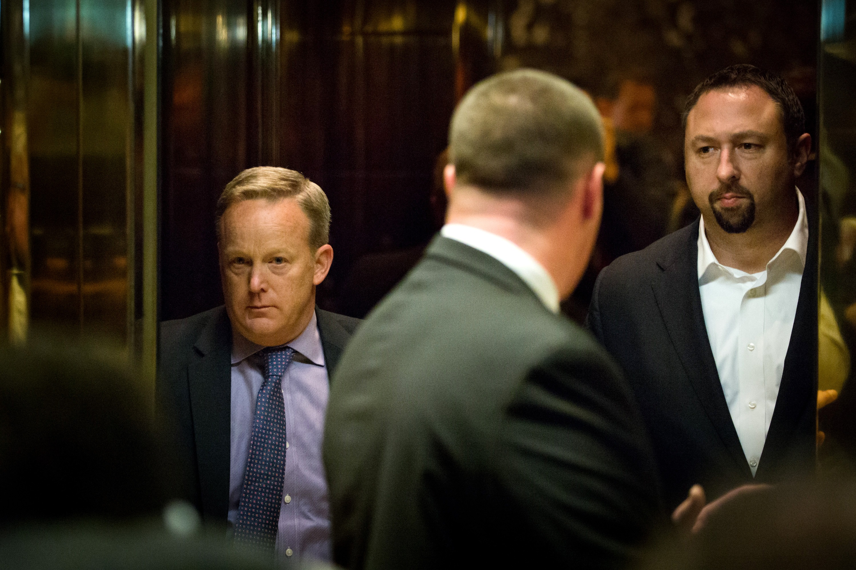 Sean Spicer, left, and Jason Miller, both senior advisors to President-elect Donald Trump, arrive at Trump Tower on November 13, 2016, in New York City (Getty Images)