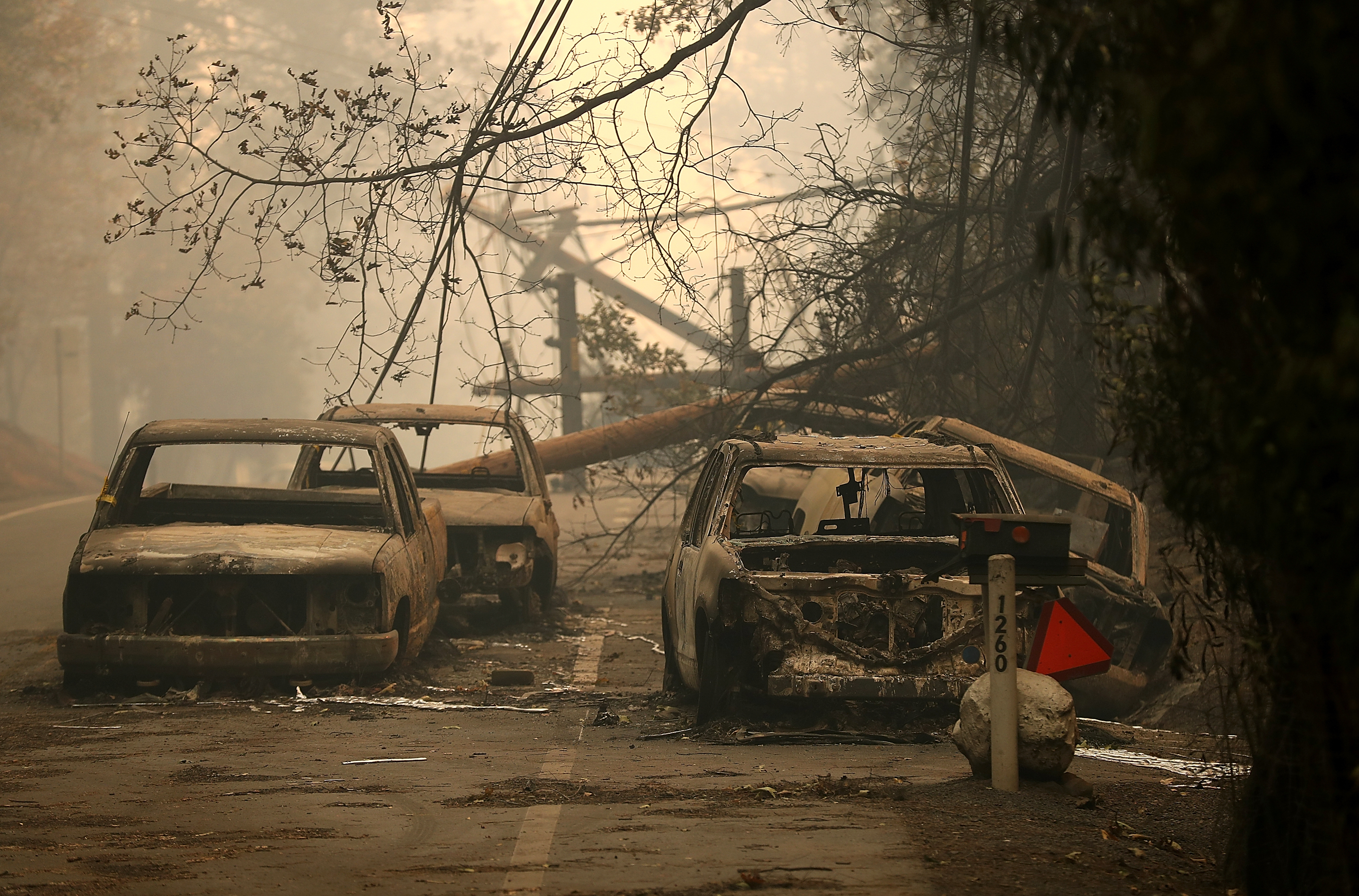 Power lines rest on cars that were burned by Camp Fire on November 10, 2018, in Paradise, California. (Getty Images)