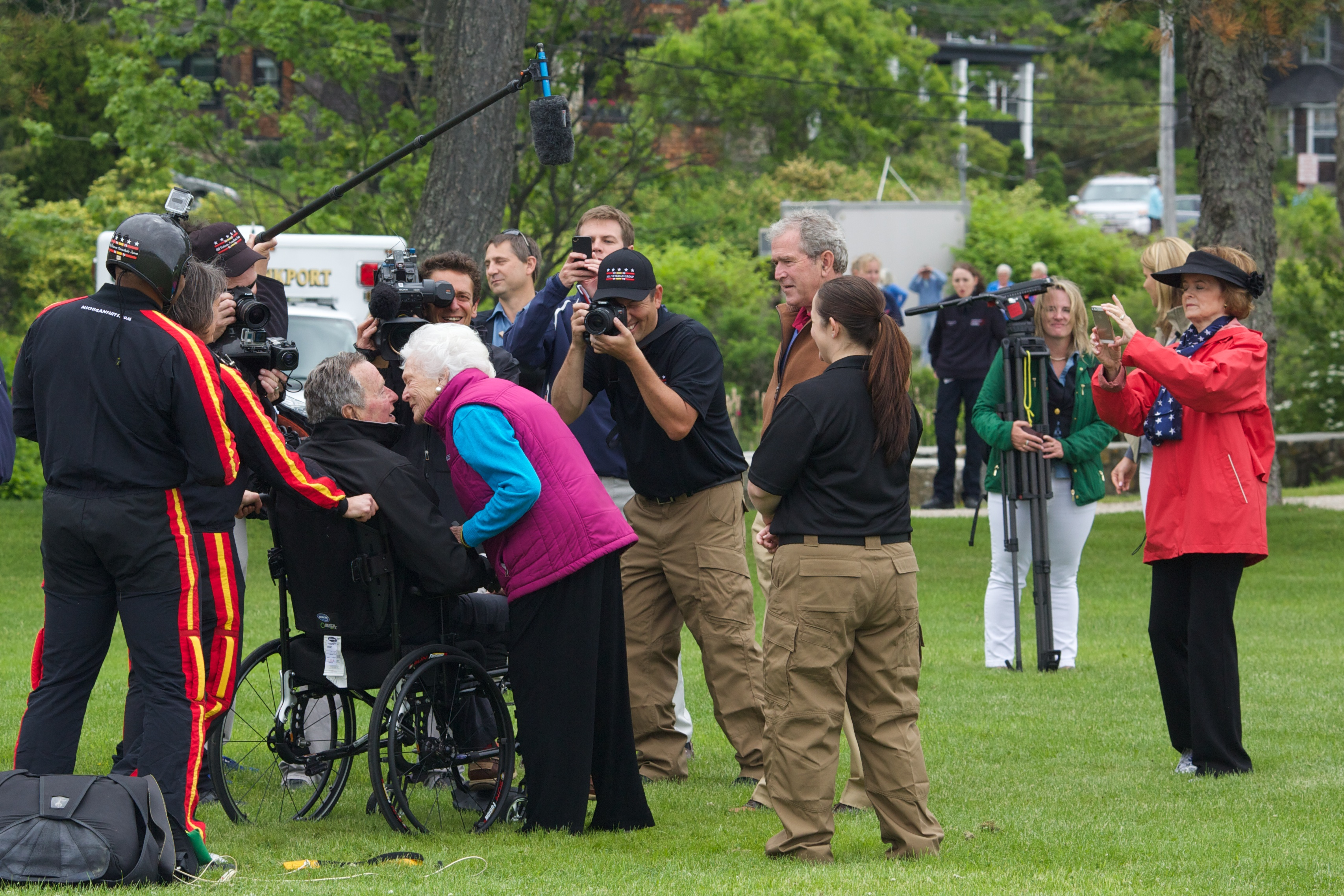 Former first lady Barbara Bush greeted her husband and former U.S. President George H.W. Bush with a kiss after his successful skydive down to St. Anne's Episcopal Church on June 12, 2014 in Kennebunkport, Maine. The President was celebrating his 90th birthday today.
