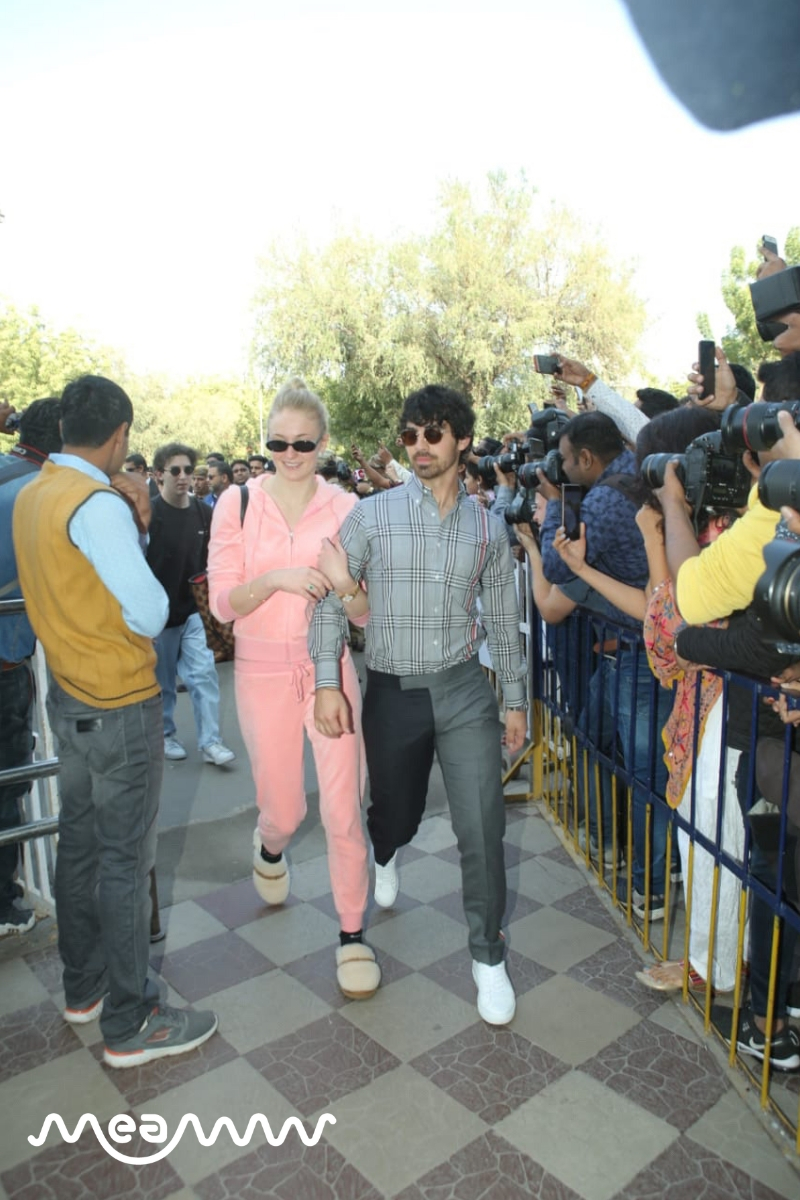 Nick's brother Joe Jonas along with his fiance Sophie Turner as they made their way towards the Jodhpur airport terminal for their travel to Delhi. (Meaww Photos)