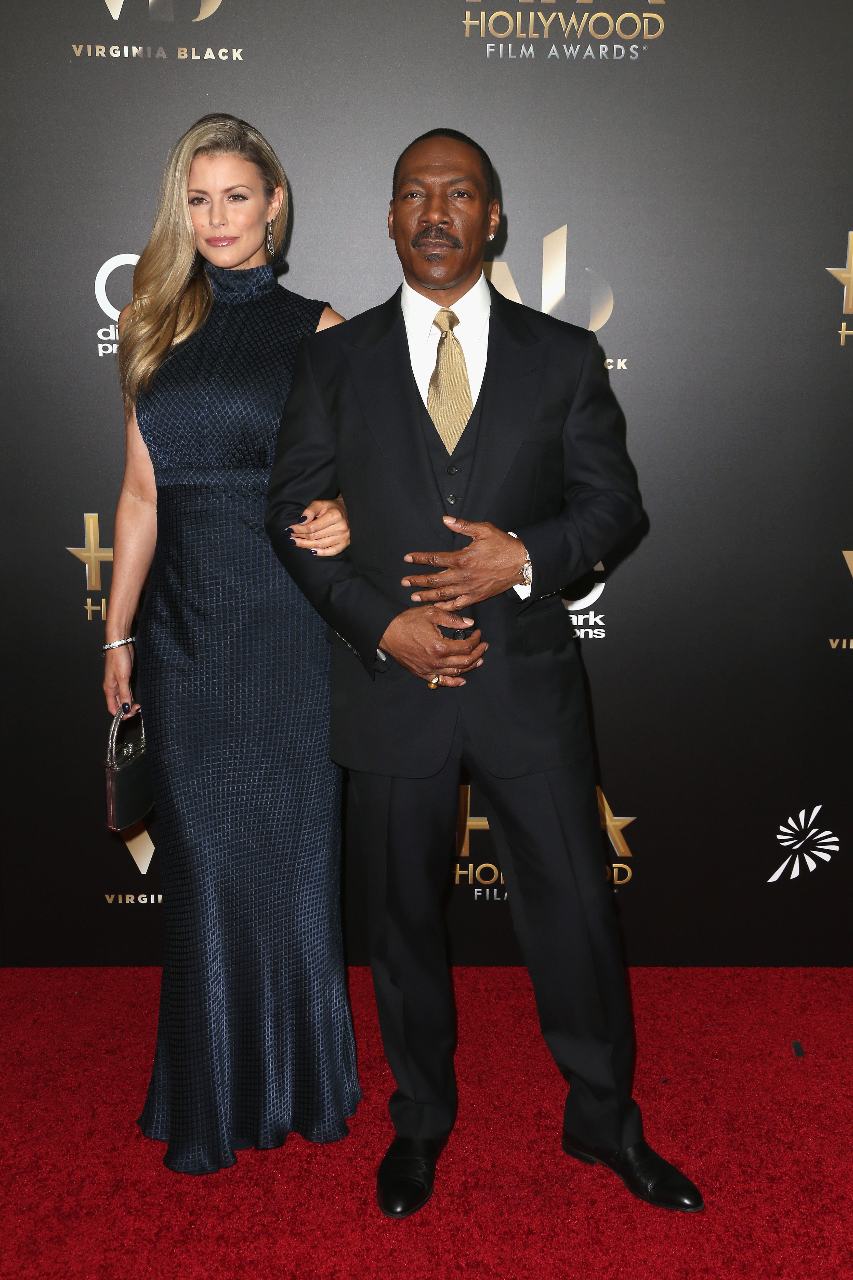 Actors Paige Butcher (L) and Eddie Murphy attend the 20th Annual Hollywood Film Awards on November 6, 2016 in Beverly Hills, California. (Photo by Frederick M. Brown/Getty Images)