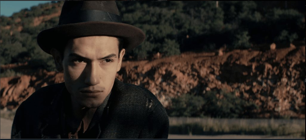 Fernando Serrano looks on in a still from Bisbee'17.