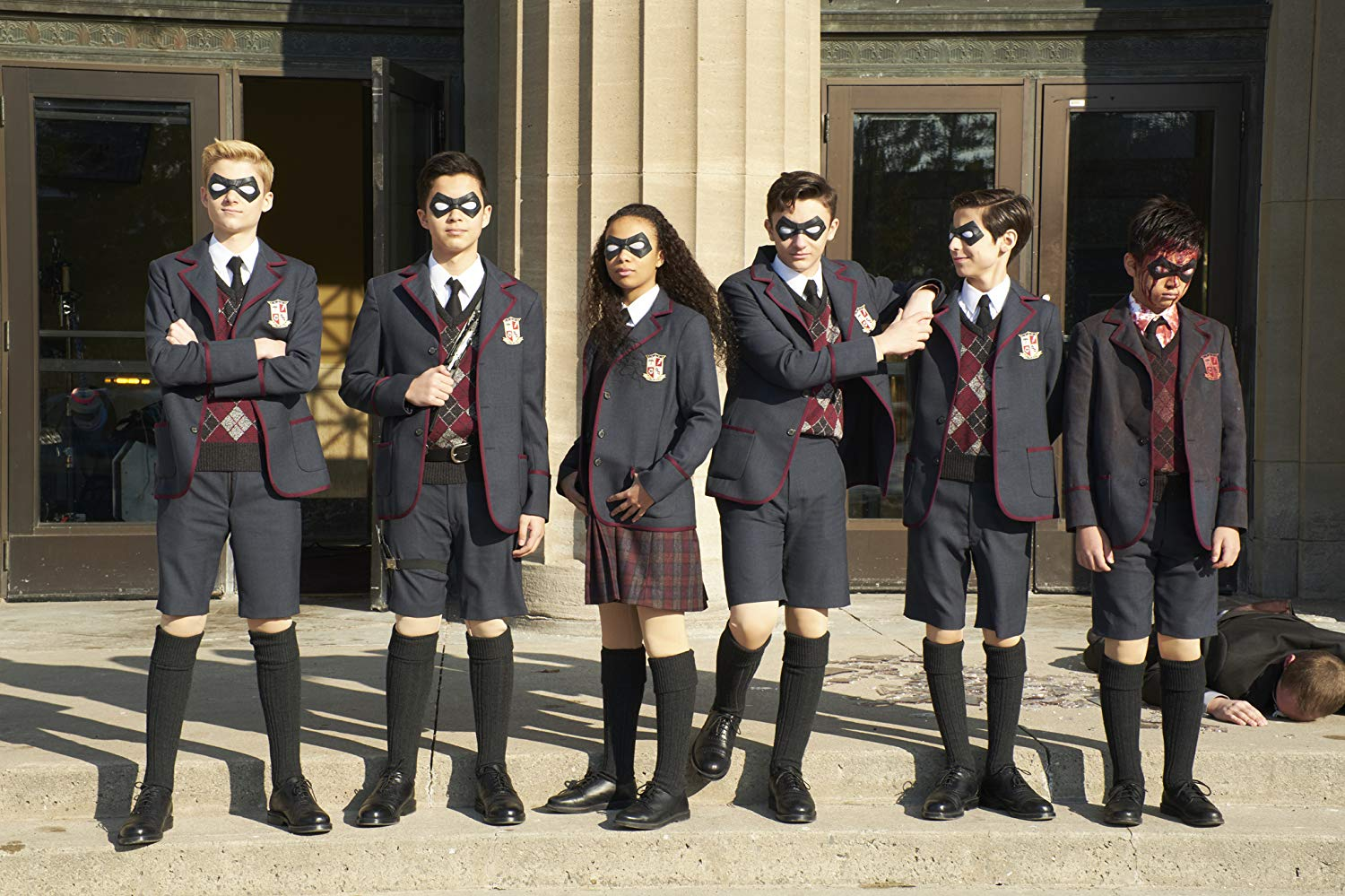Dante Albidone, Aidan Gallagher, Cameron Brodeur, Eden Cupid, Ethan Hwang, and Blake Talabis in The Umbrella Academy (2019) Source: IMDB