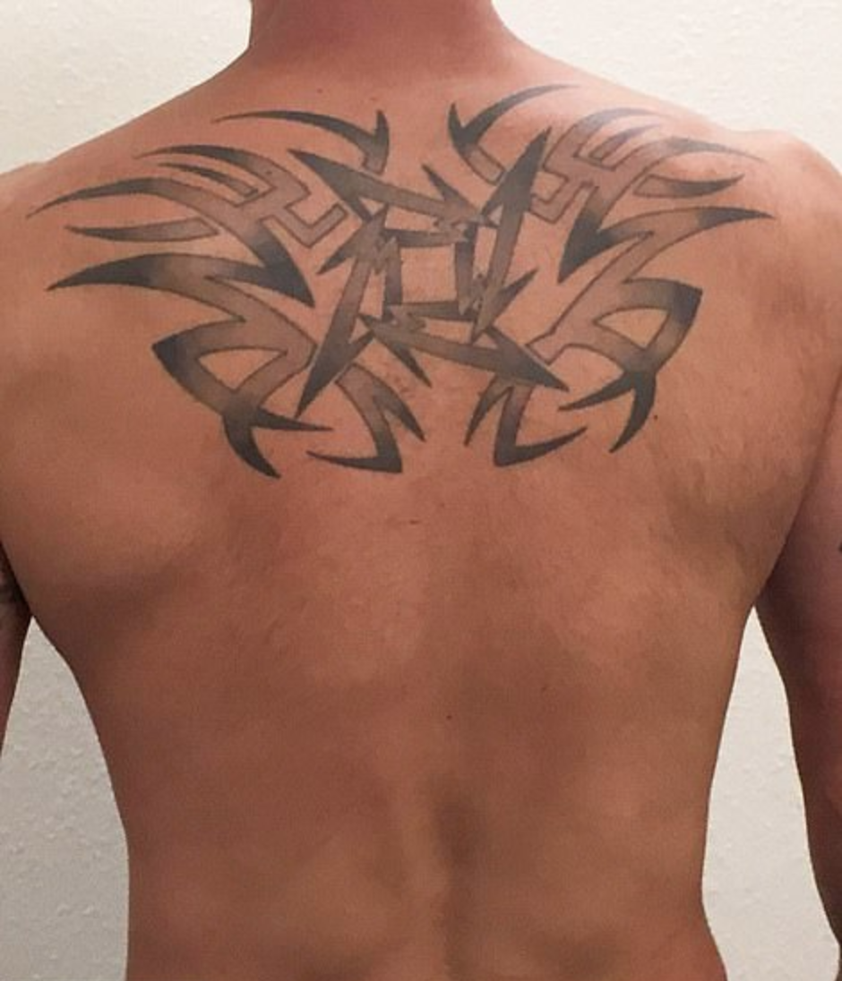 The giant Metallica tattoo on Watts' upper back (Source: Weld County District Attorney's Office)