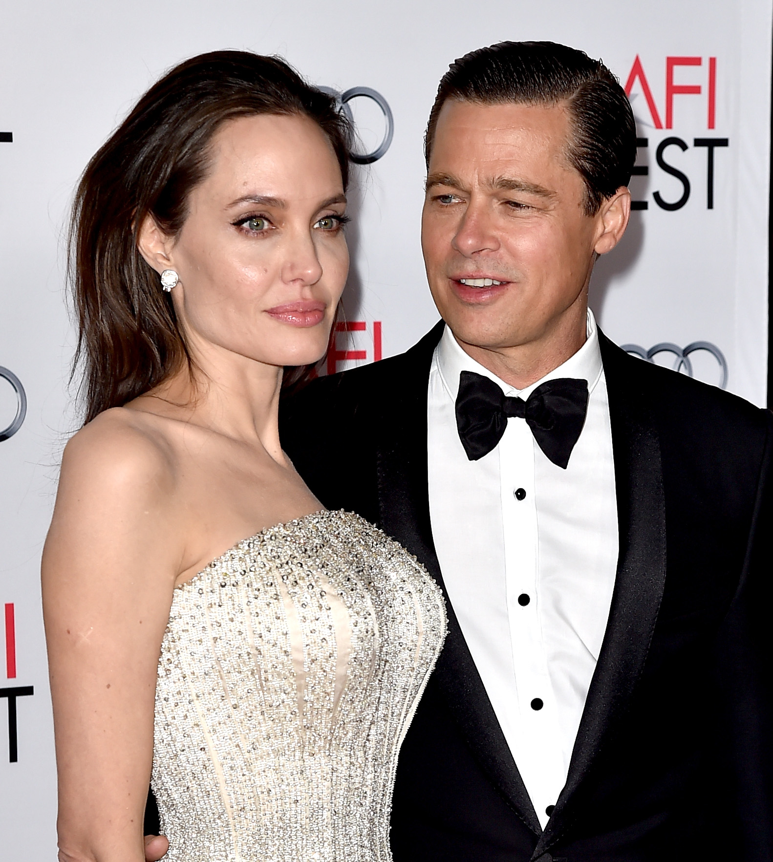 Angelina Jolie Pitt (L) and husband actor Brad Pitt arrive at the AFI FEST 2015 presented by Audi opening night gala premiere of Universal Pictures' 'By The Sea' at the Chinese Theatre on November 5, 2015 in Los Angeles, California. (Photo by Kevin Winter/Getty Images)