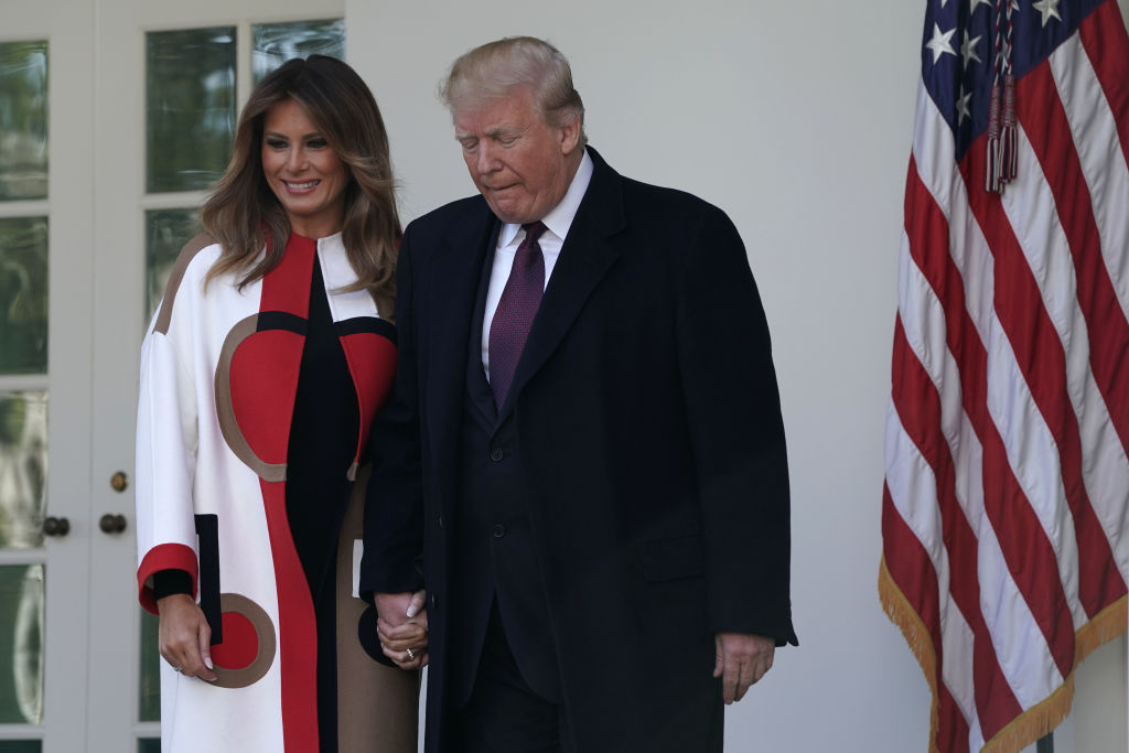 U.S. President Donald Trump (R) and first lady Melania Trump (L) arrive at a turkey pardoning event at the Rose Garden of the White House November 20, 2018 in Washington, DC. (Photo by Alex Wong/Getty Images)