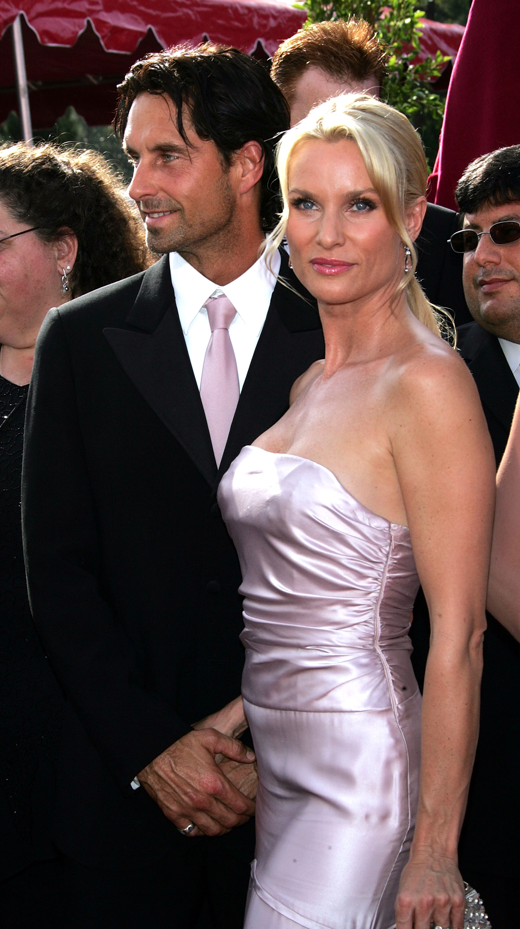 Actress Nicollette Sheridan (R) and her husband Harry Hamlin arrive at the 57th Annual Emmy Awards held at the Shrine Auditorium on September 18, 2005, in Los Angeles, California. (Getty Images)