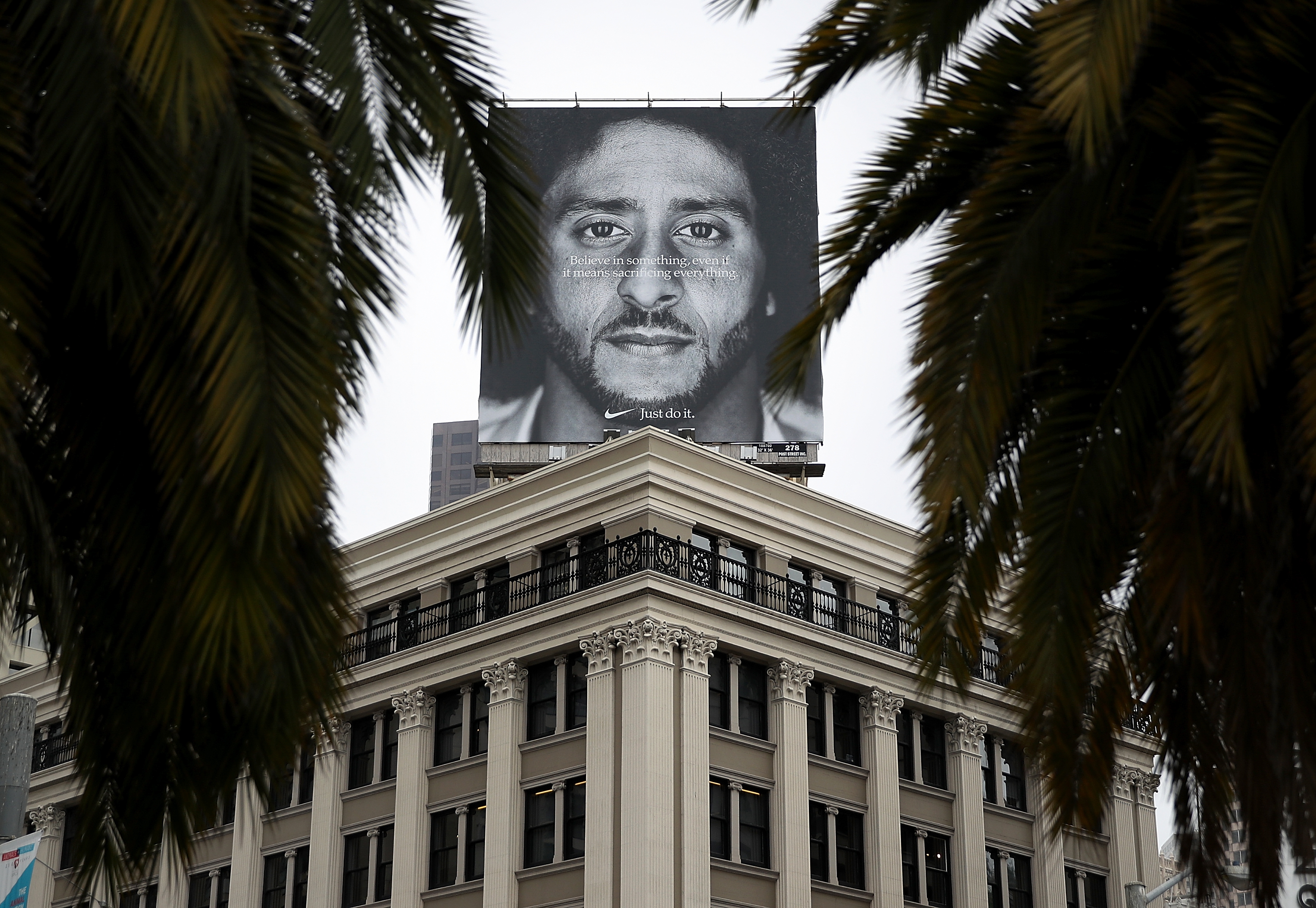 A billboard featuring former San Francisco 49ers quarterback Colin Kaepernick is displayed on the roof of the Nike Store on September 5, 2018, in San Francisco, California. (Getty)
