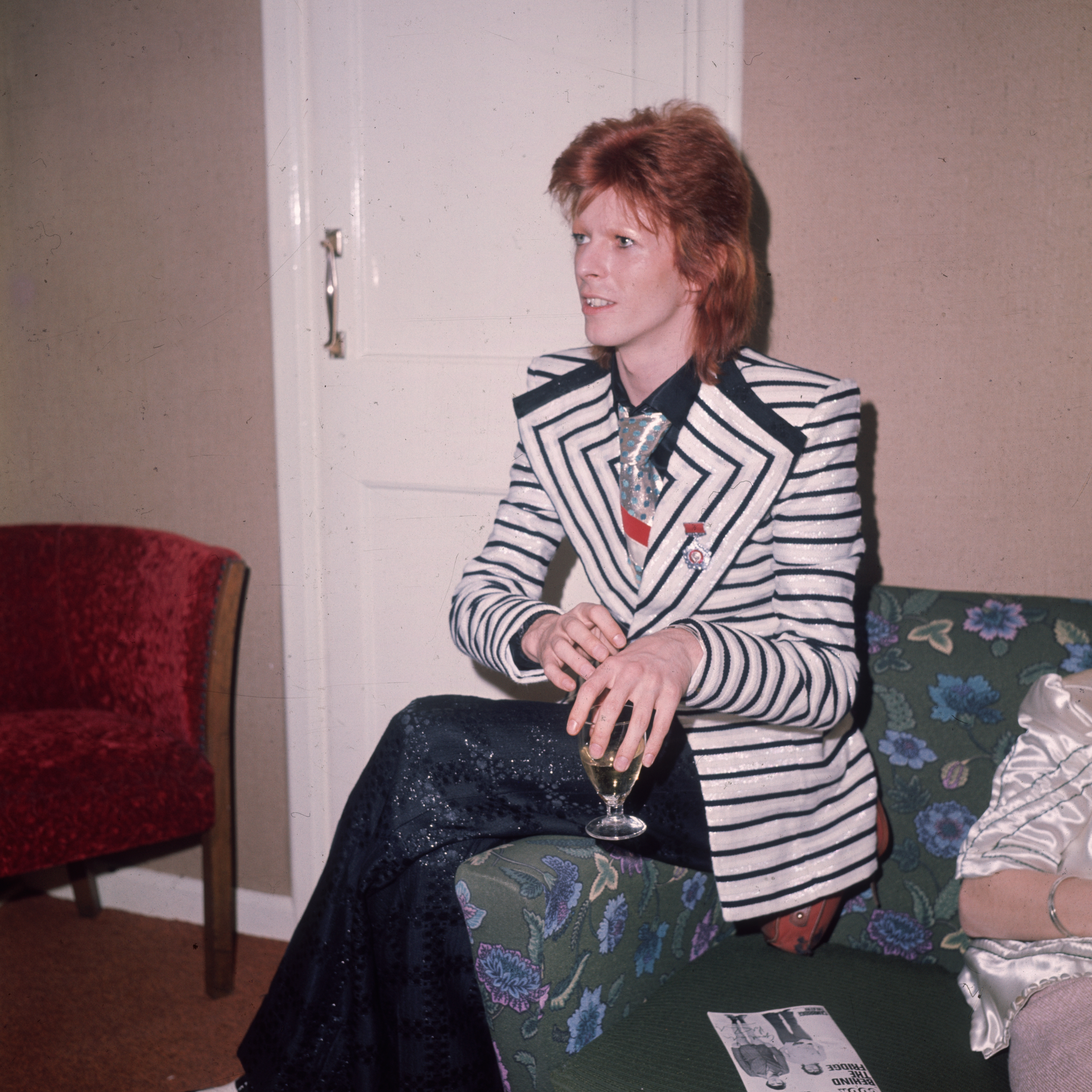 In a black and white horizontally striped jacket with wide lapels glam rock star David Bowie. Source: Getty