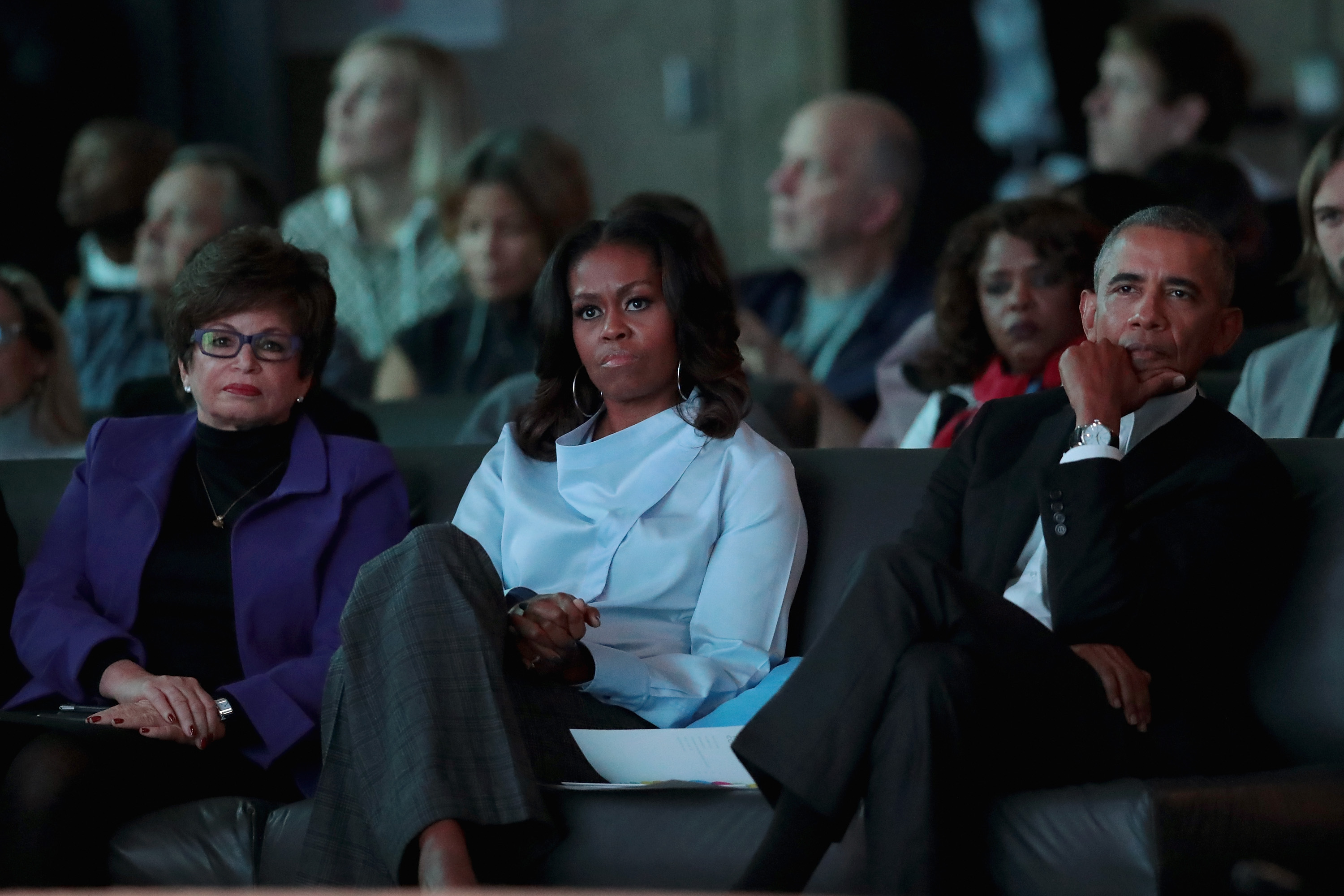 Former advisor to the president Valerie Jarrett (L) and former first Lady Michelle and president Barack Obama listen to speakers at the inaugural Obama Foundation Summit on October 31, 2017 in Chicago, Illinois. (Photo by Scott Olson/Getty Images)