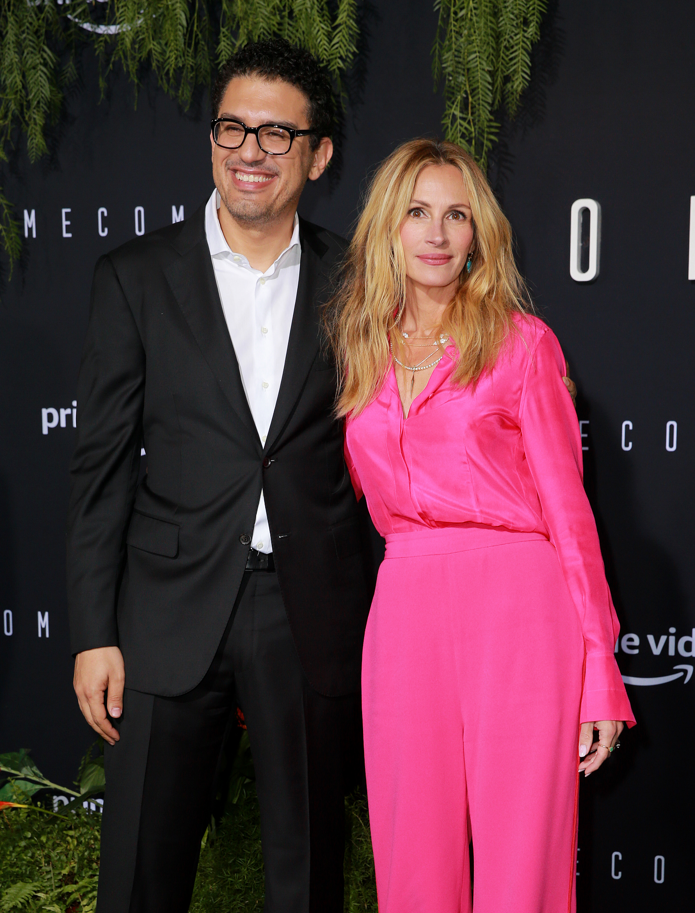 Director/executive producer Sam Esmail (L) and actor Julia Roberts attend the premiere of Amazon Studios' 'Homecoming' at Regency Bruin Theatre on October 24, 2018 in Los Angeles, California.