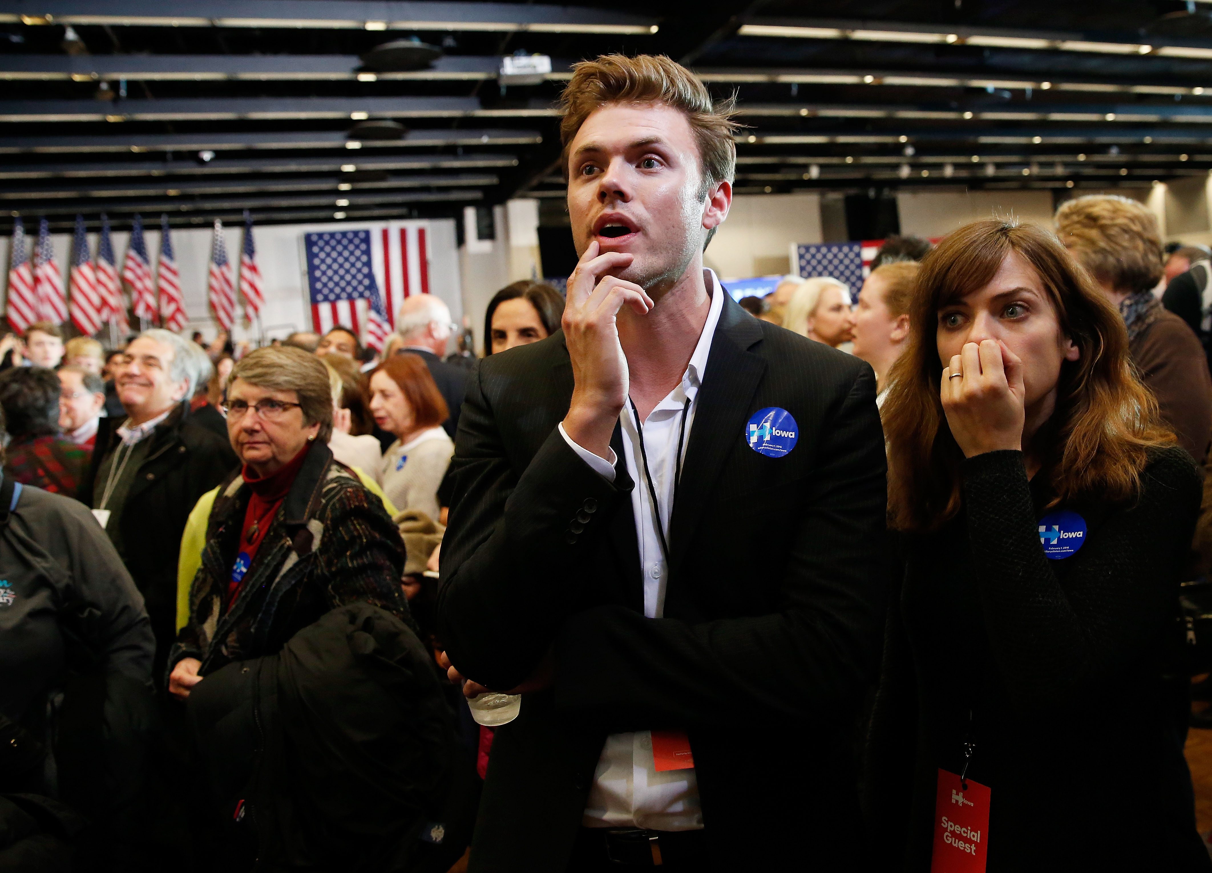 HRC volunteer and actor Blake Cooper Griffin (L) from Los Angeles, California and other supporters watch as results are displayed on a television during the caucus night event of Democratic presidential candidate former Secretary of State Hillary Clinton in the Olmsted Center at Drake University on February 1, 2016 in Des Moines, Iowa. Clinton, Sen. Bernie Sanders (I-VT) and Martin O'Malley are competing in the Iowa Democratic caucus.