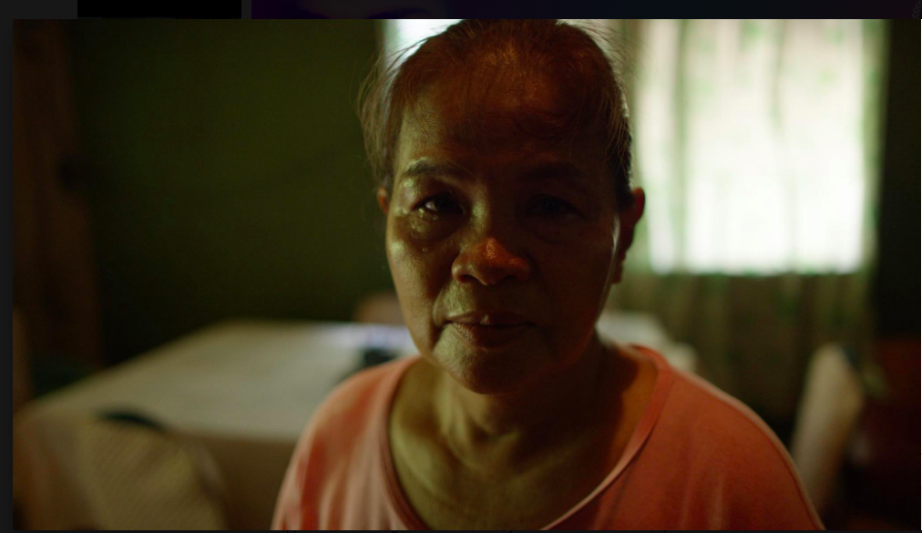 Jennifer's mother Julita Laude looks at the camera in a still from Call Her Ganda.